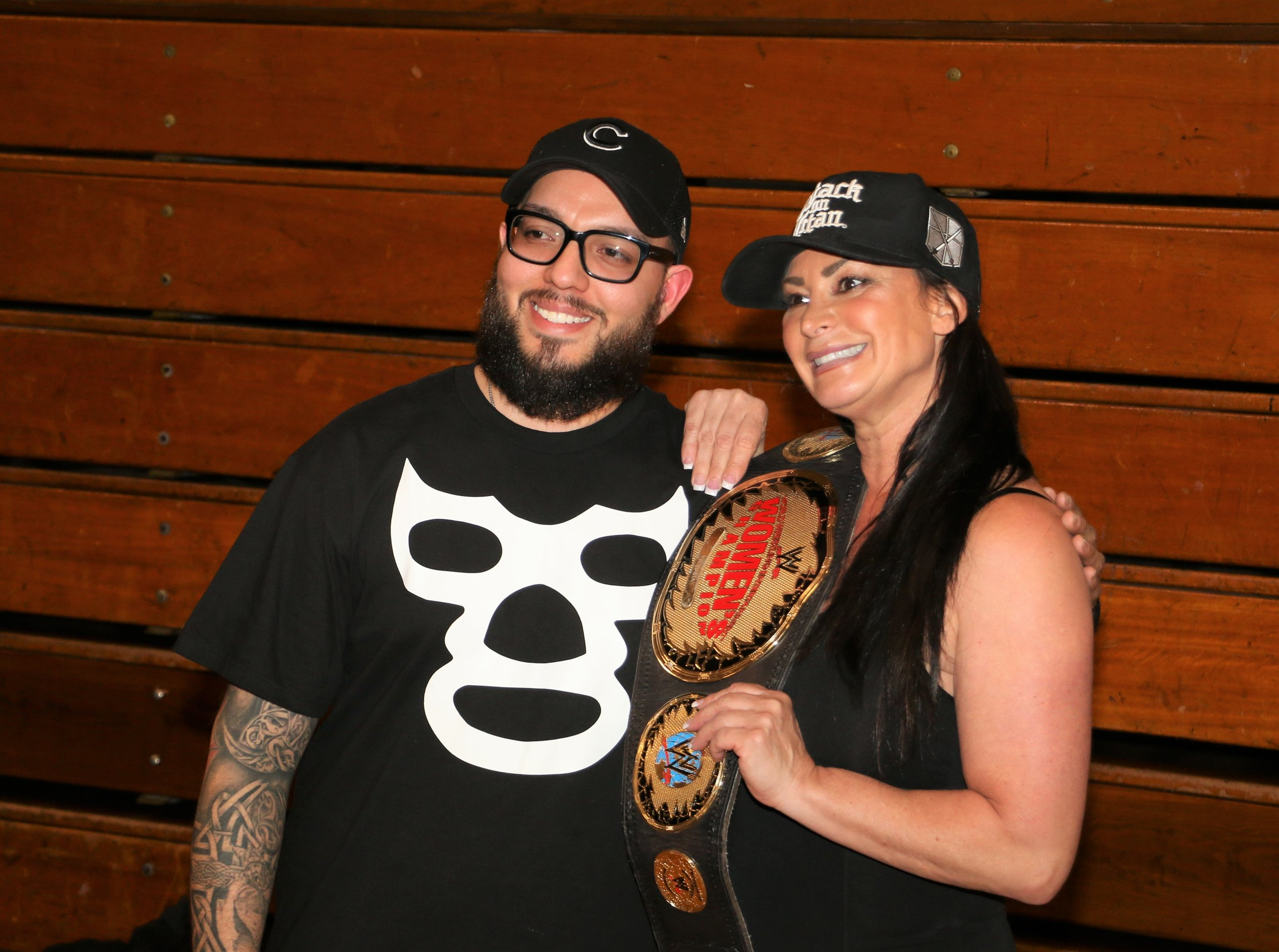 Lisa Marie Varon (formerly Victoria in WWE), right, poses with a fan at Warrior Wrestling 4 in March 2019. Varon will appear all four days at Wizard World Chicago in Rosemont this weekend.  (Photo by Mike Pankow)
