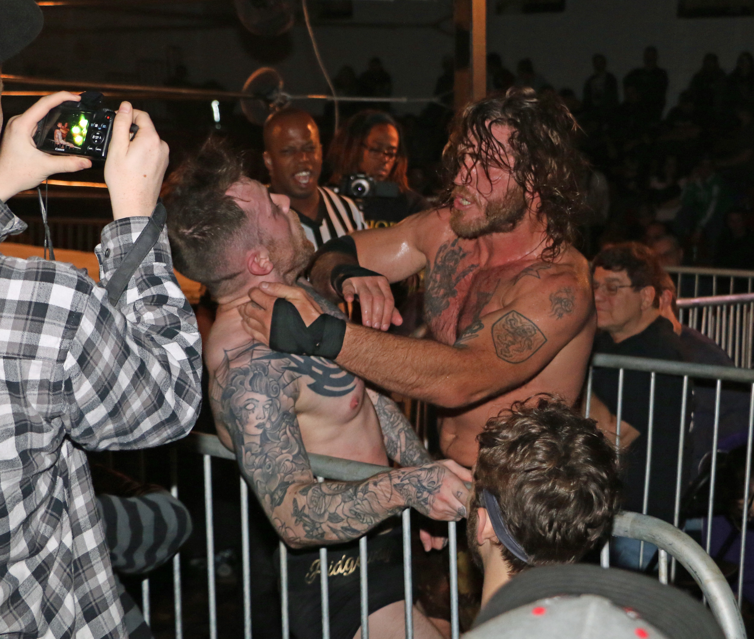 """""""Filthy"""" Tom Lawlor, right, fighting Chris Ridgeway at Warrior Wrestling 5, will appear at GCW/BLP's """"2 Cups Stuffed"""" on Friday night and Warrior Wrestling 6 on Sunday night.  (Photo by Mike Pankow)"""