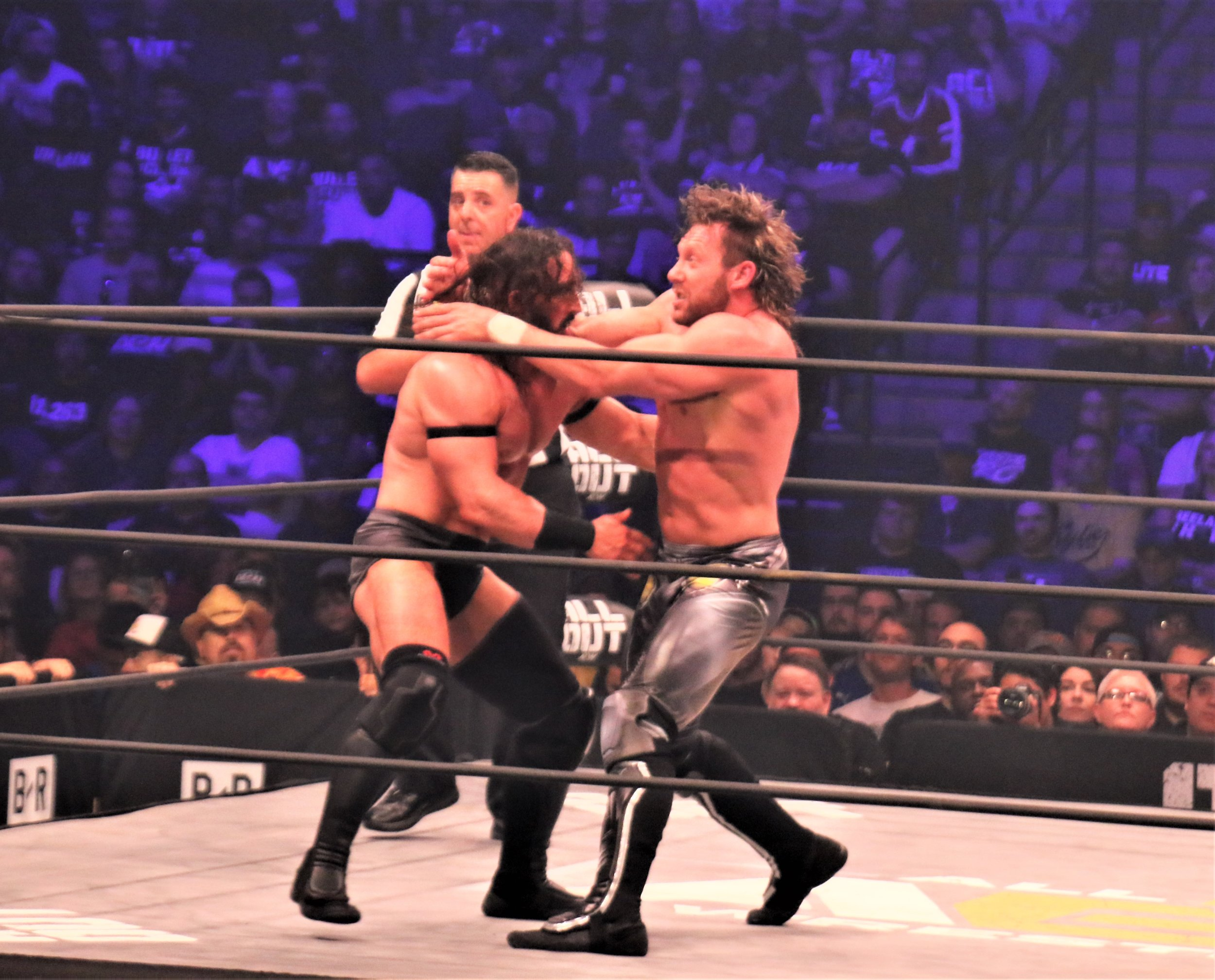 PAC, left, and Kenny Omega slug it out in what arguably was the best match of the night, in which PAC pulled off the upset.  (Photo by Mike Pankow)