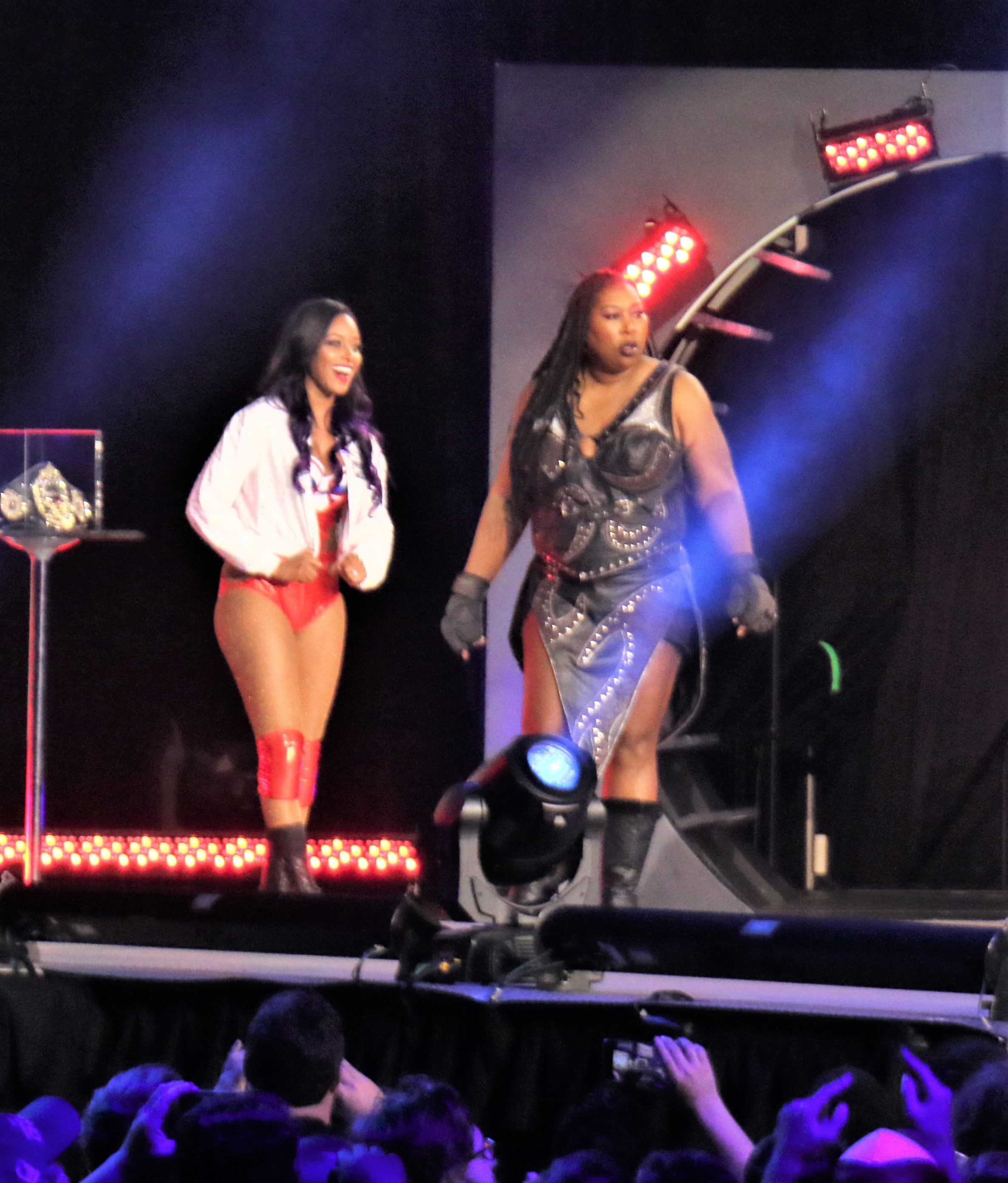 Brandi Rhodes, left, and Awesome Kong enter the arena for the Casino Battle Royale.