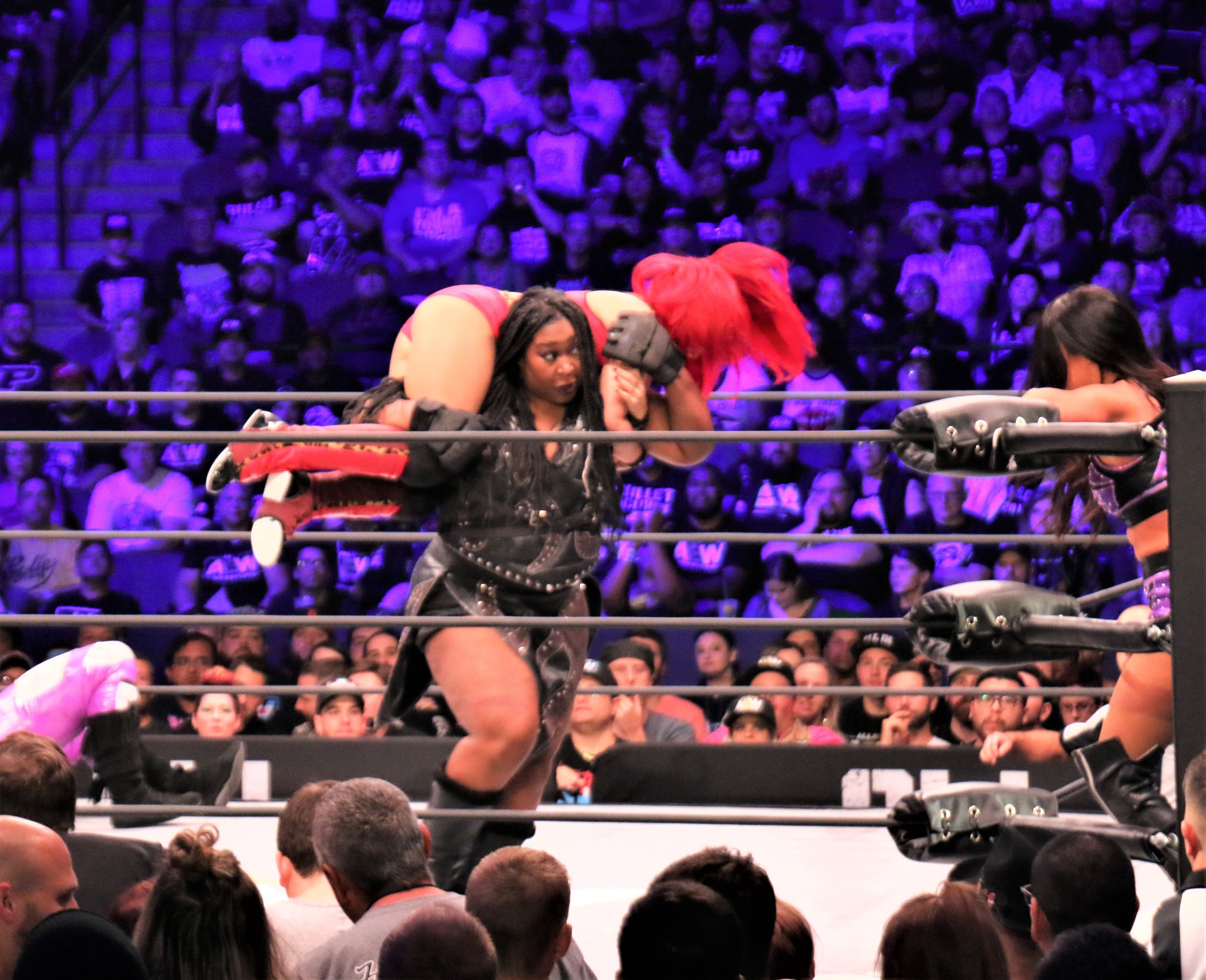 Awesome Kong hoists Ivelisse into the air during the Casino Battle Royale.