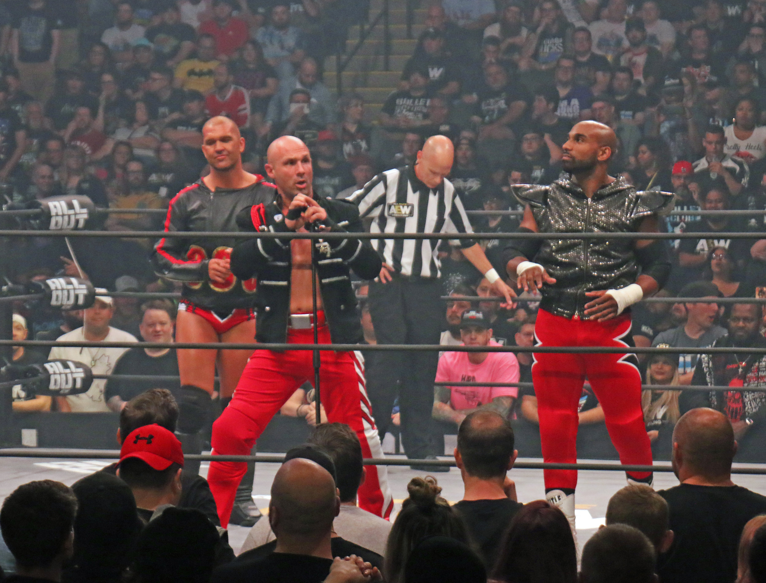 SCU riles up the crowd before the six-man tag team match.