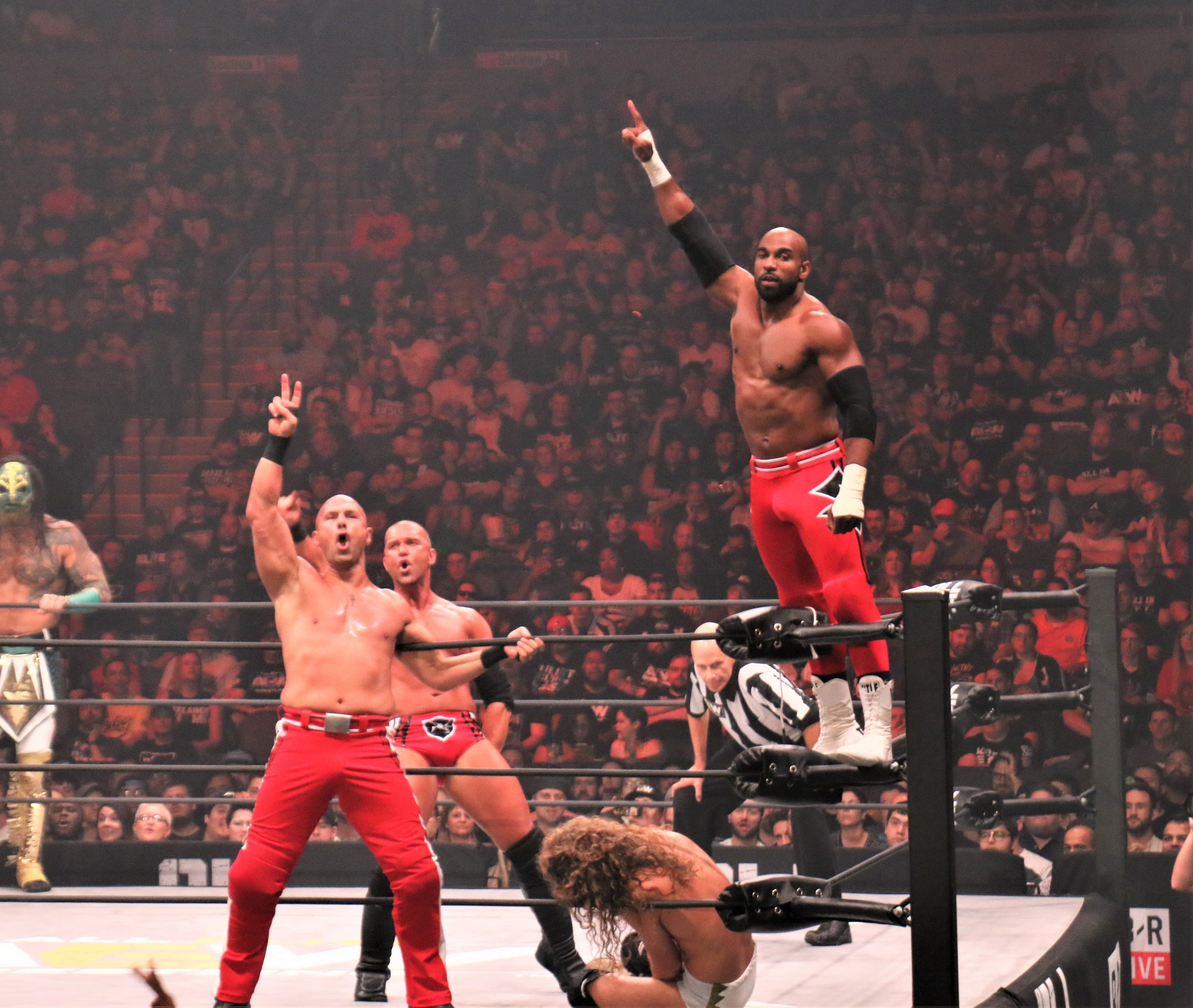 SCU takes a moment to celebrate during the six-man tag team match.