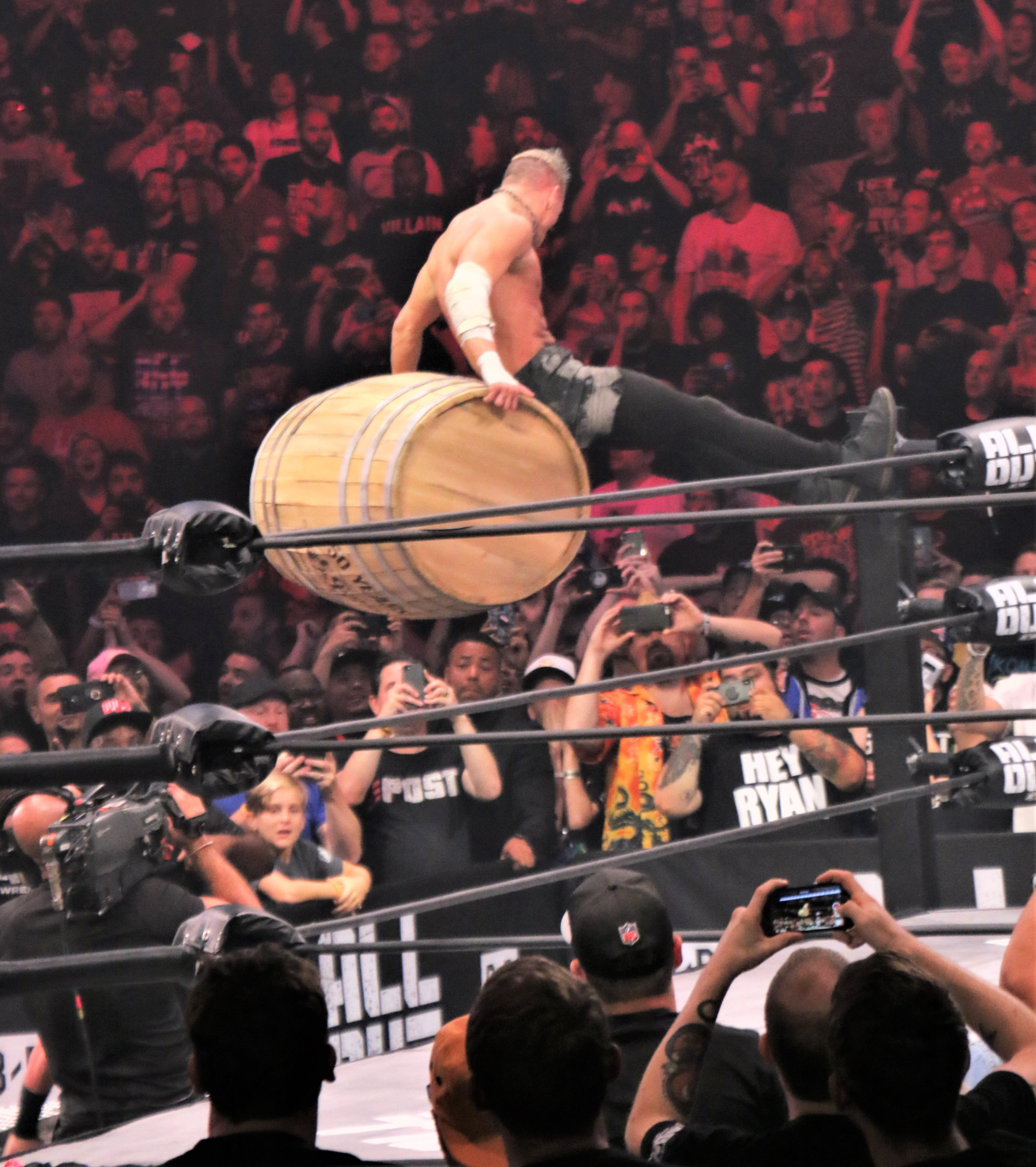 "Darby Allin goes for the Coffin Drop with the barrel during the ""Cracker Barrel Clash."""