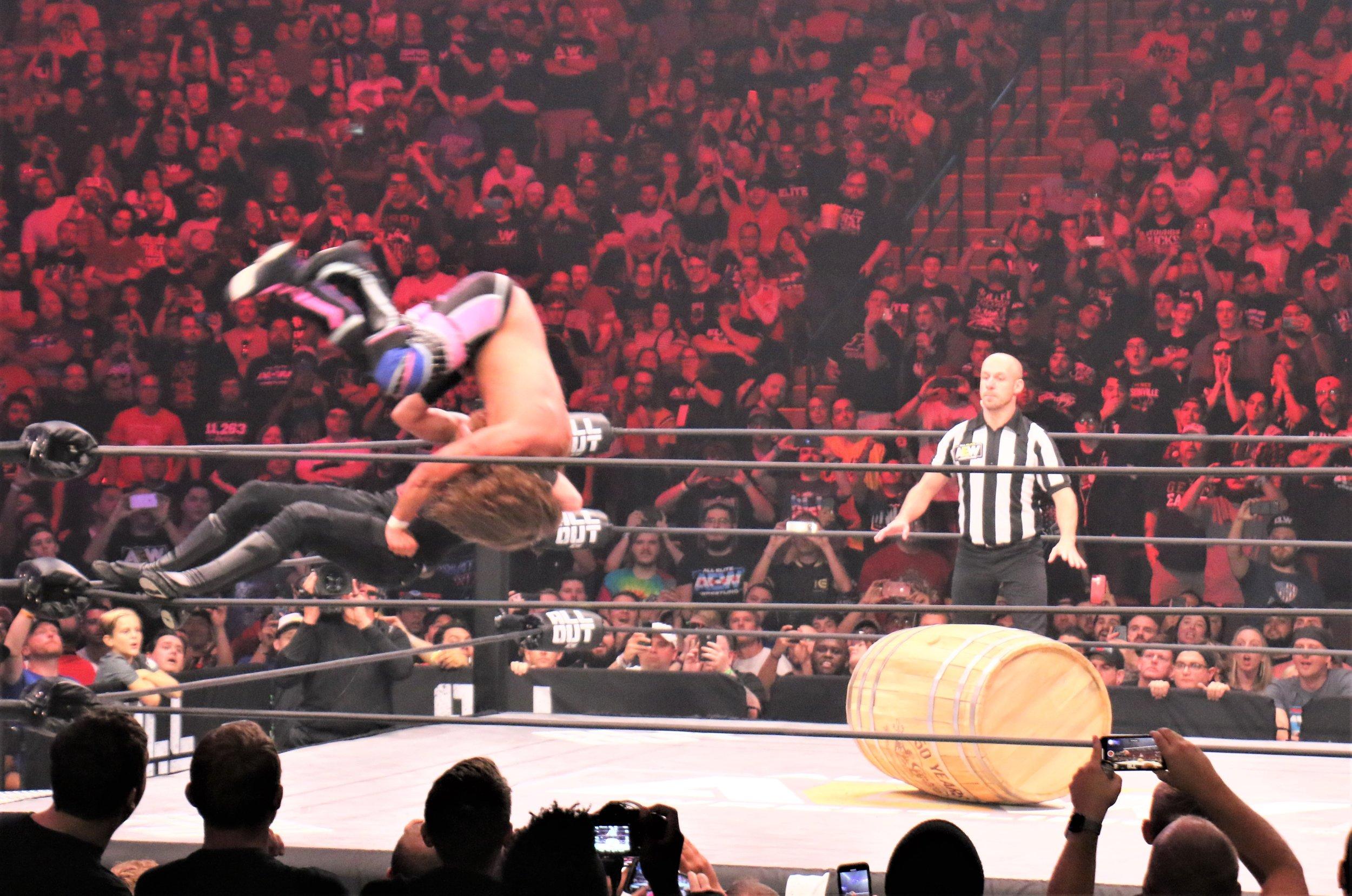 Jimmy Havoc suplexes Joey Janela onto the barrel.