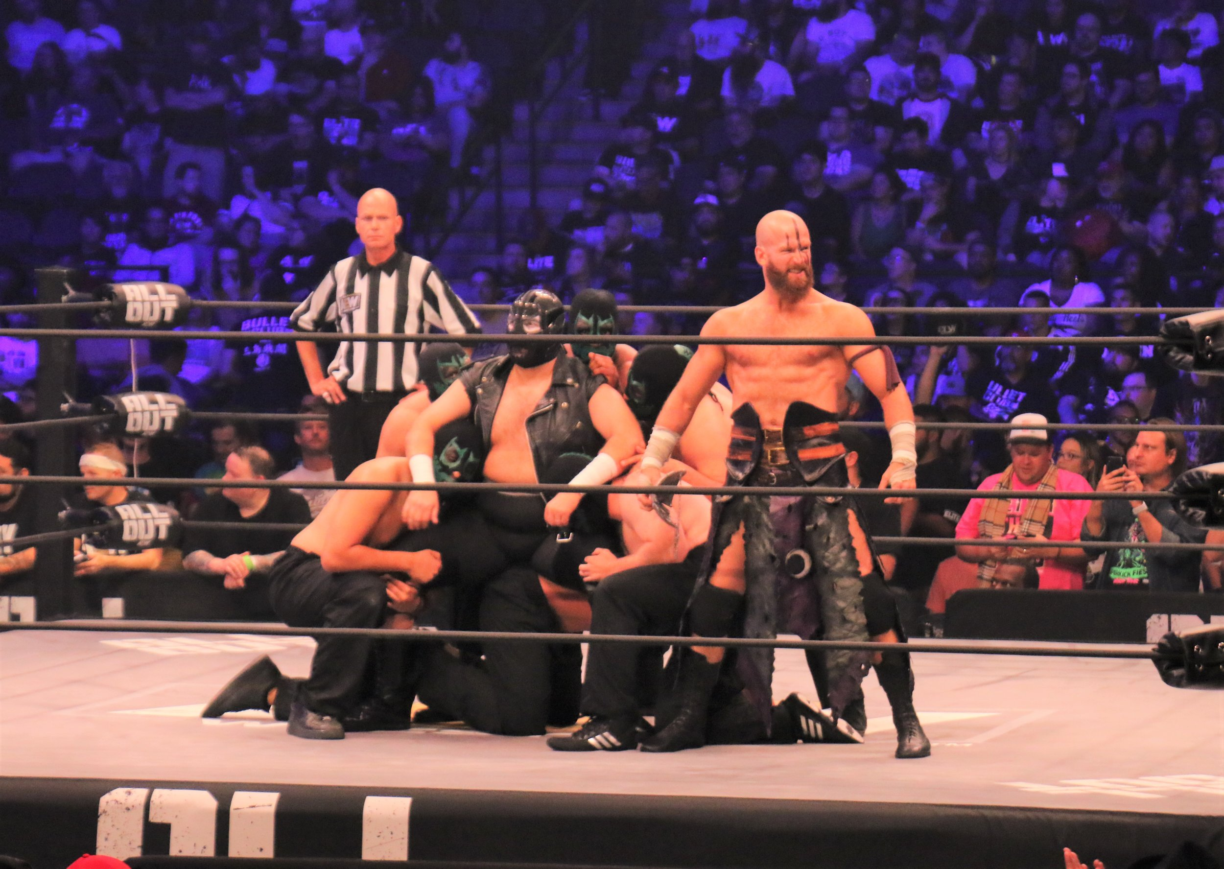 Members of the Dark Order hit the ring.