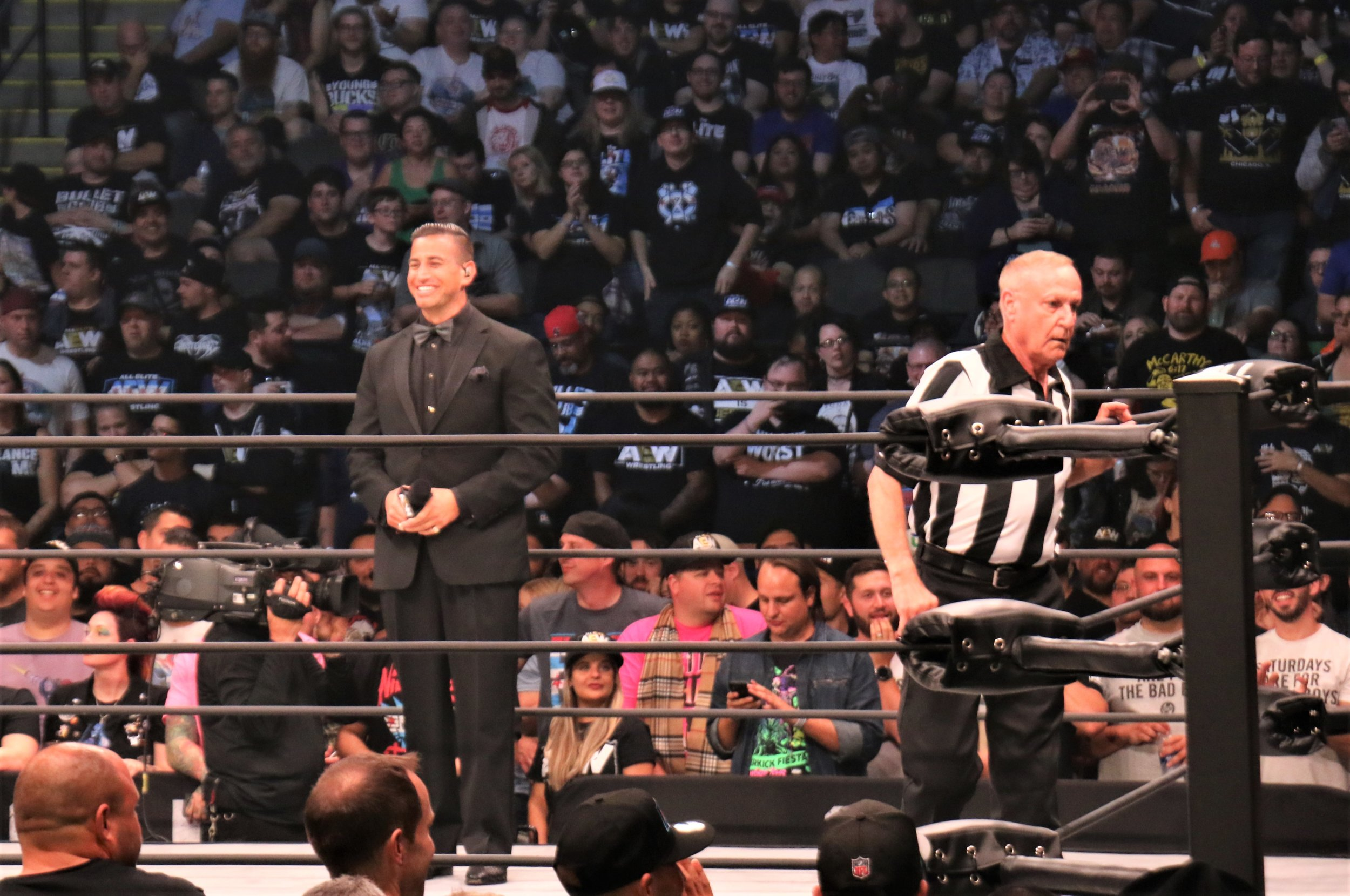 Ring announcer Justin Roberts, left, and referee Earl Hebner before the Cody Rhodes-Shawn Spears match.