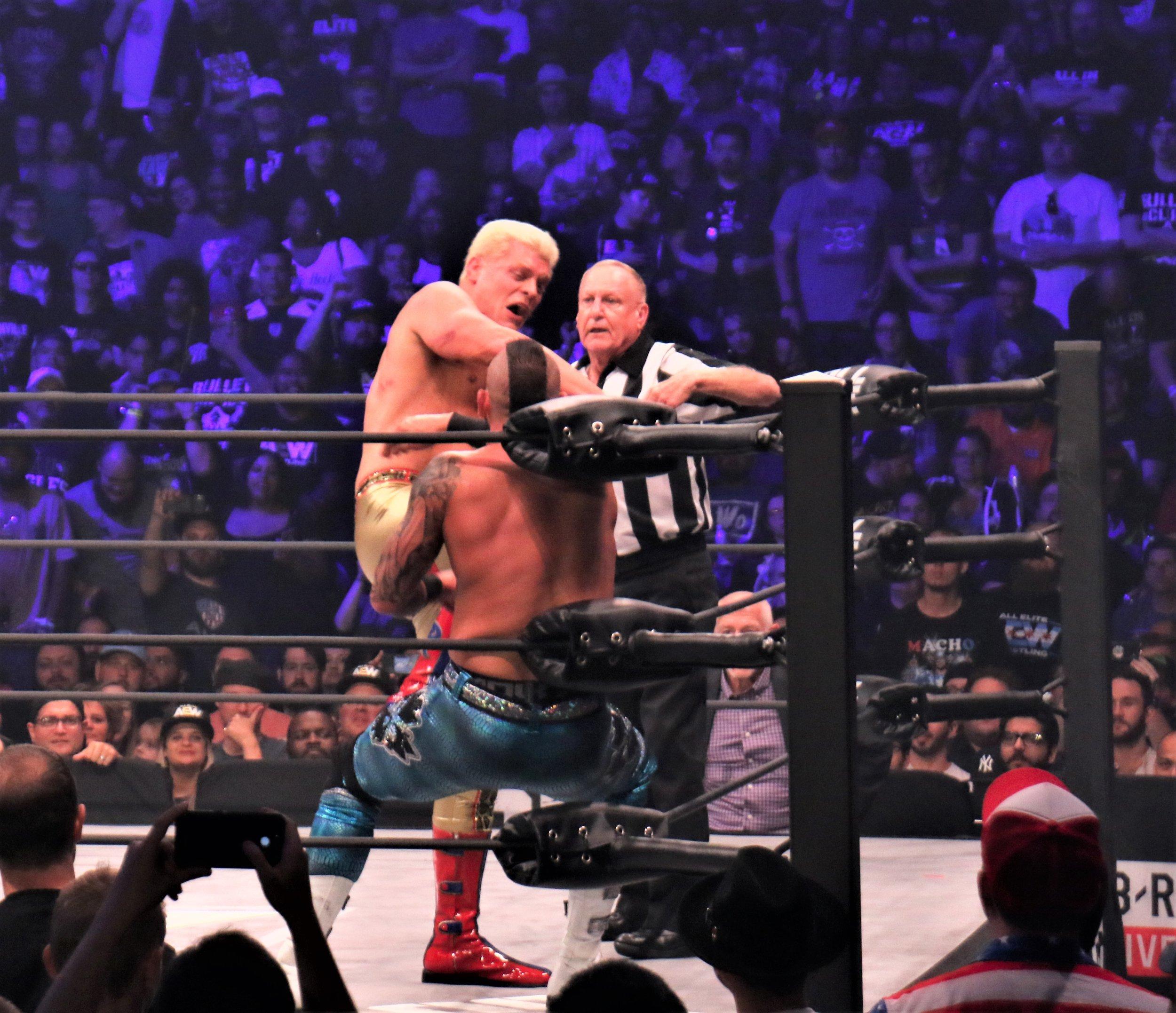 Cody kicks Shawn Spears in the corner.