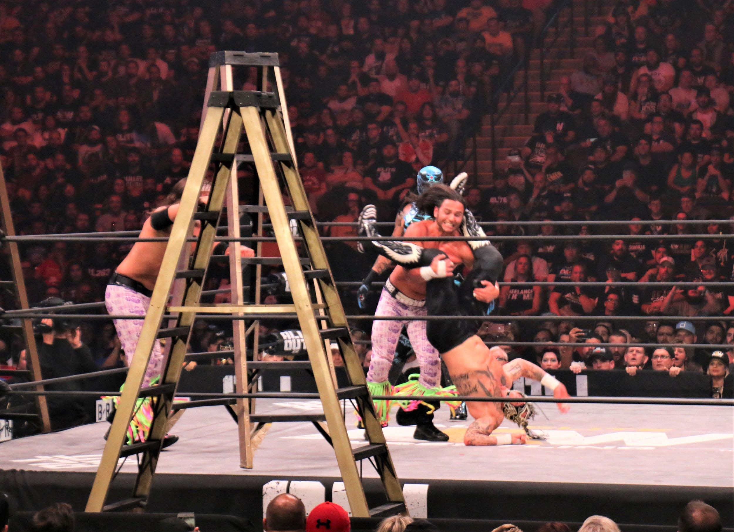 Rey Fenix hits a hurricanrana on Matt Jackson.