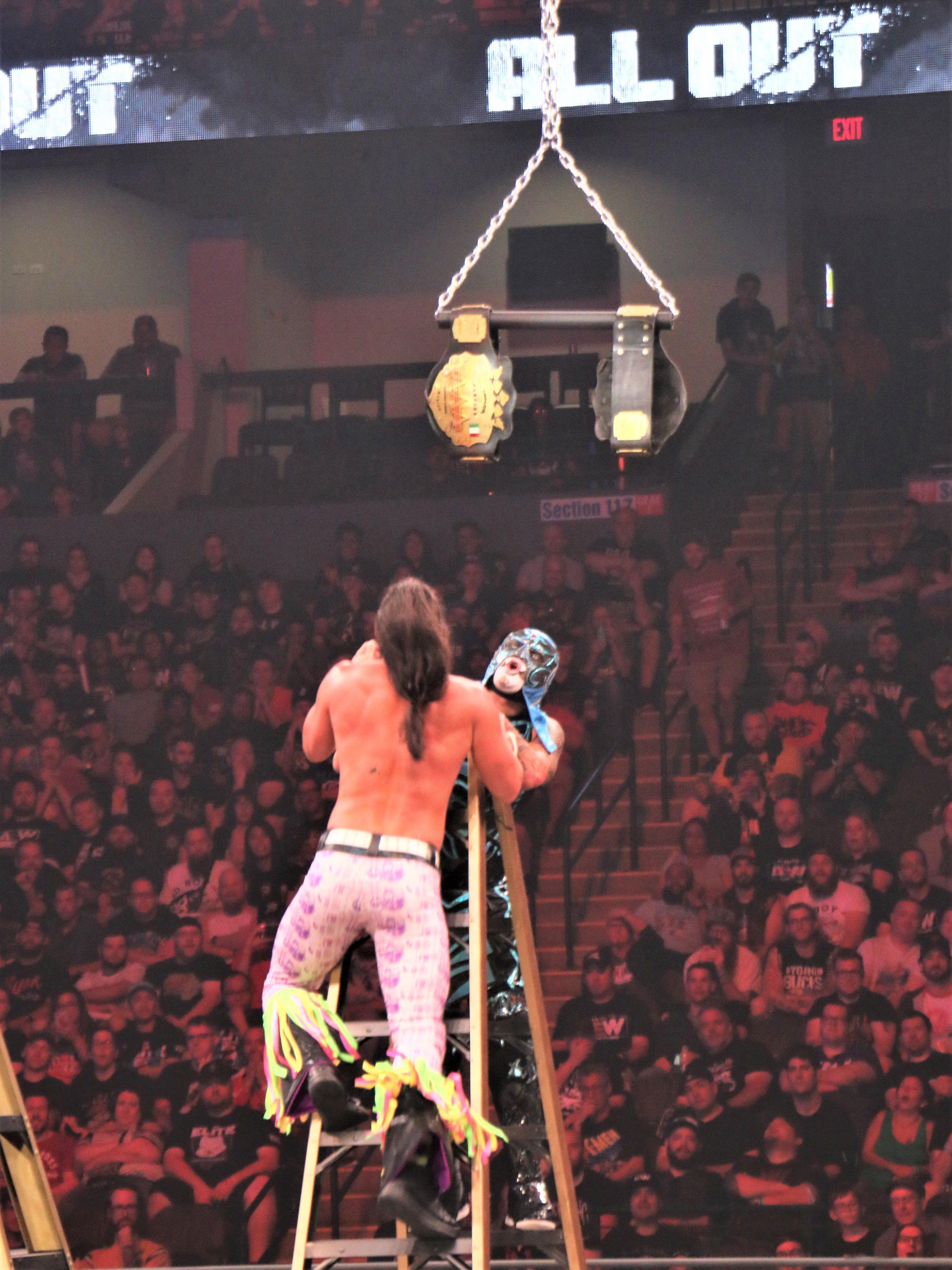 """Matt Jackson and Pentagon El 0M climb toward the AAA Tag Team belts during the """"Escalera de la Muerte"""" ladder match."""
