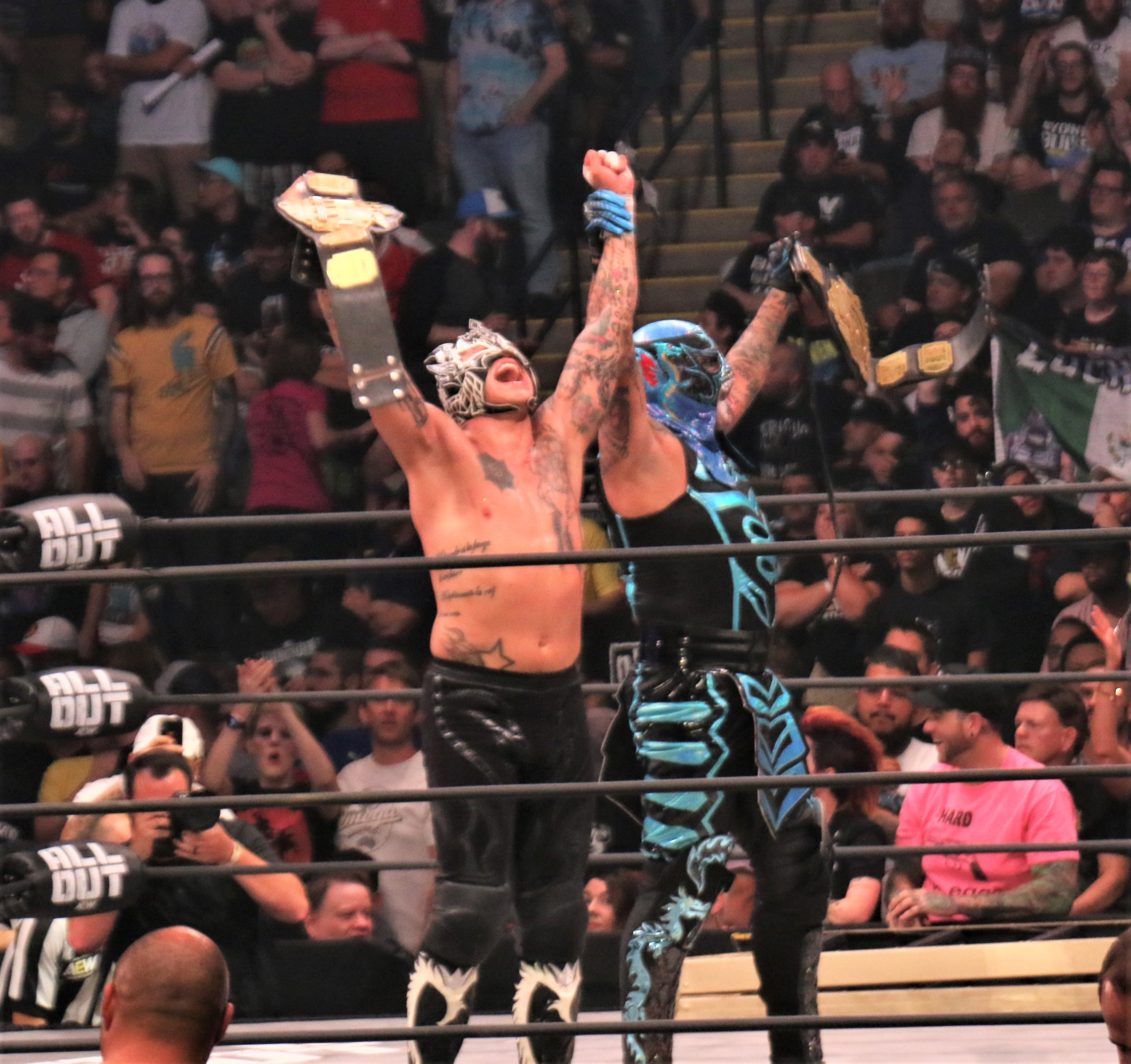 The Lucha Bros celebrate their victory!