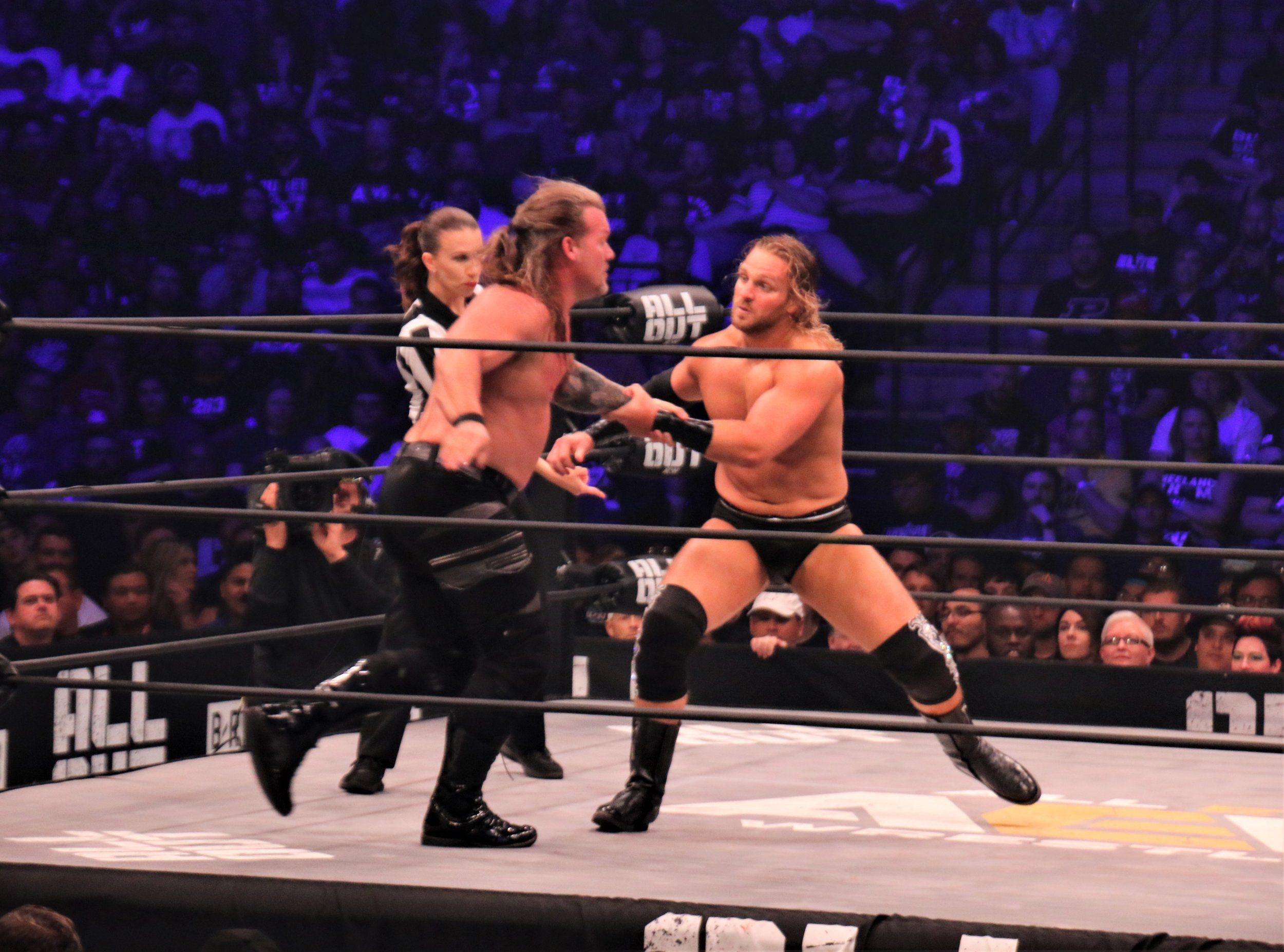 Hangman Page goes for the Irish whip on Chris Jericho.