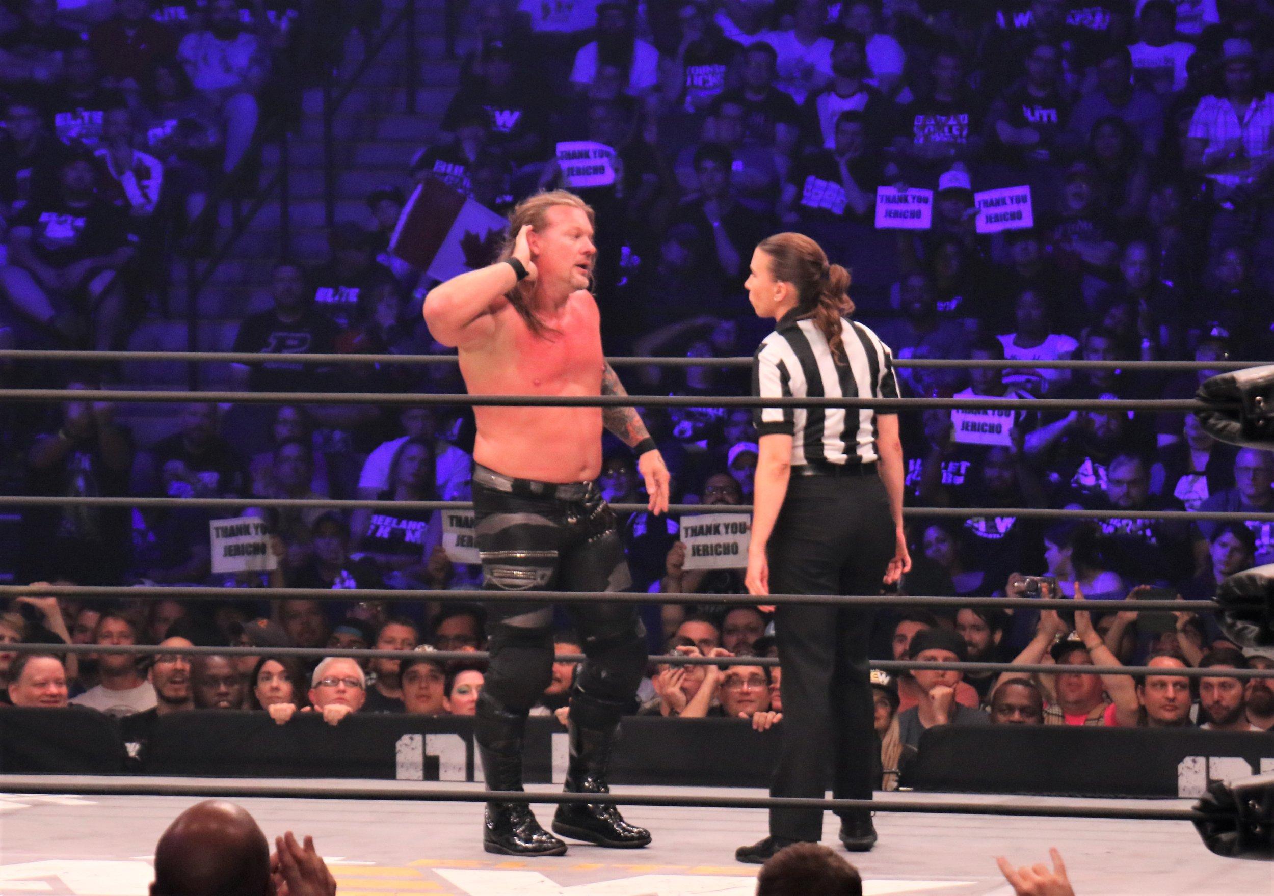 Referee Aubrey Edwards admonishes Chris Jericho.