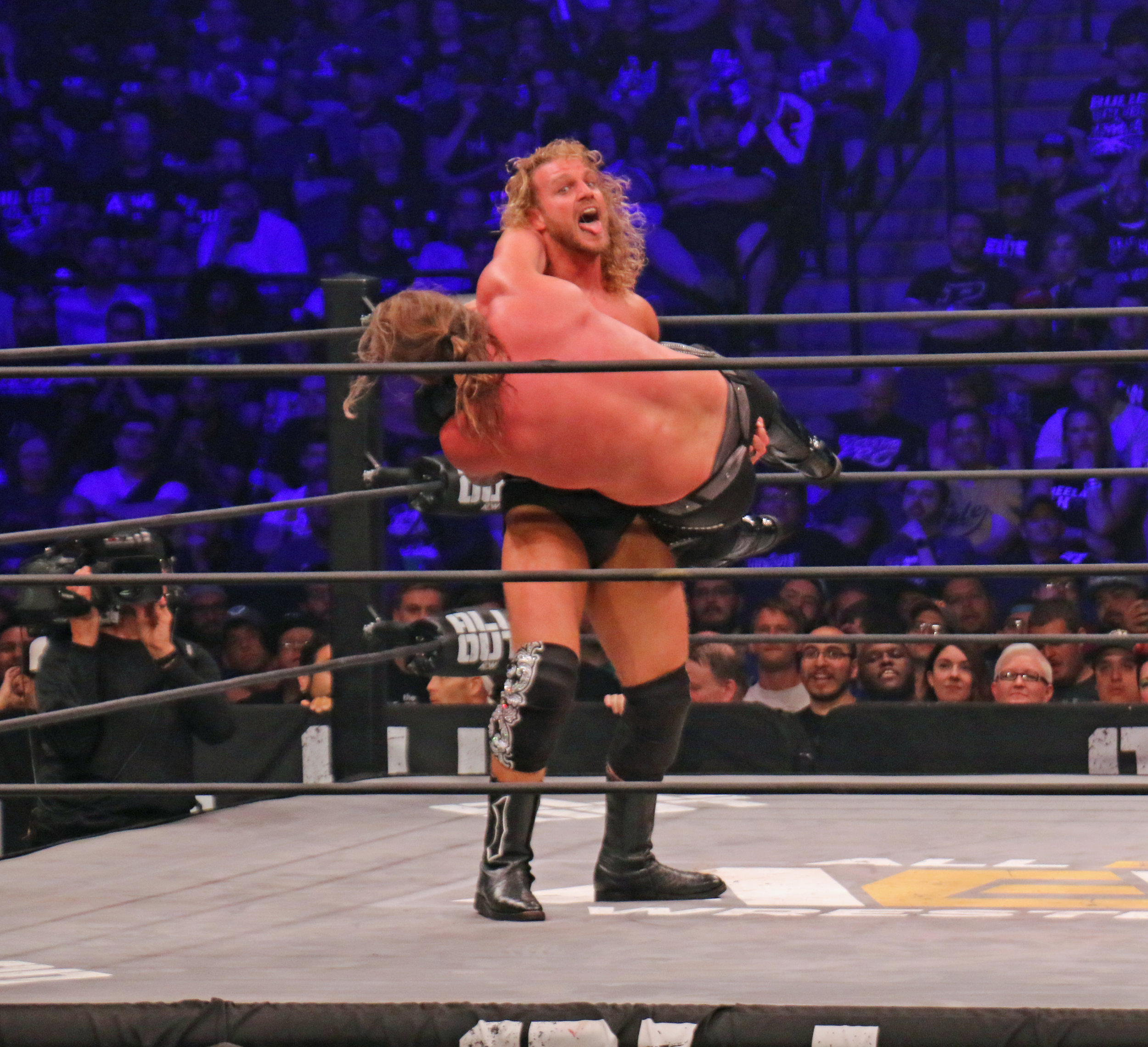 Hangman Page has control of Chris Jericho during the AEW Championship match.