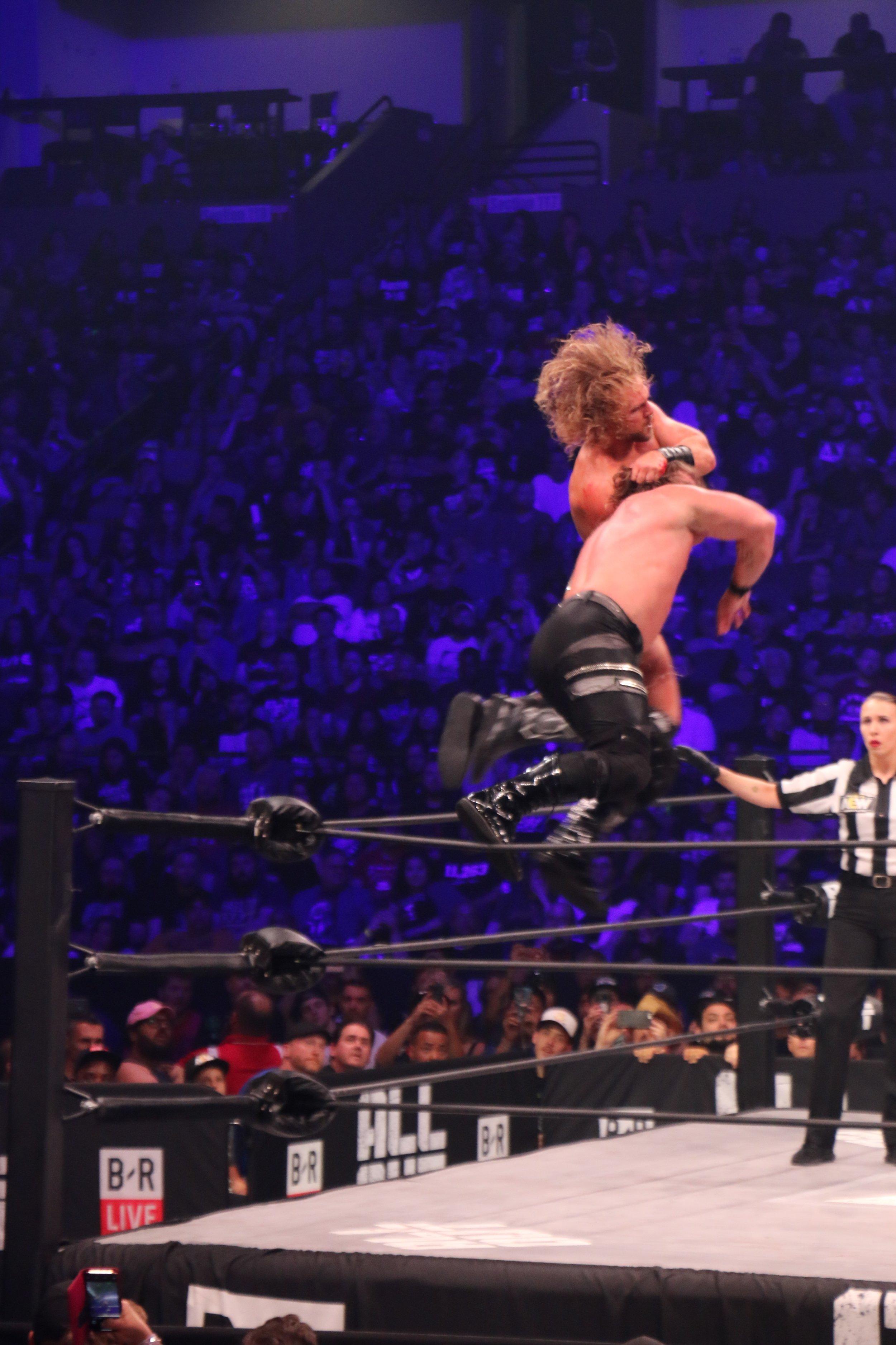 Hangman Page hits a bulldog on Chris Jericho.