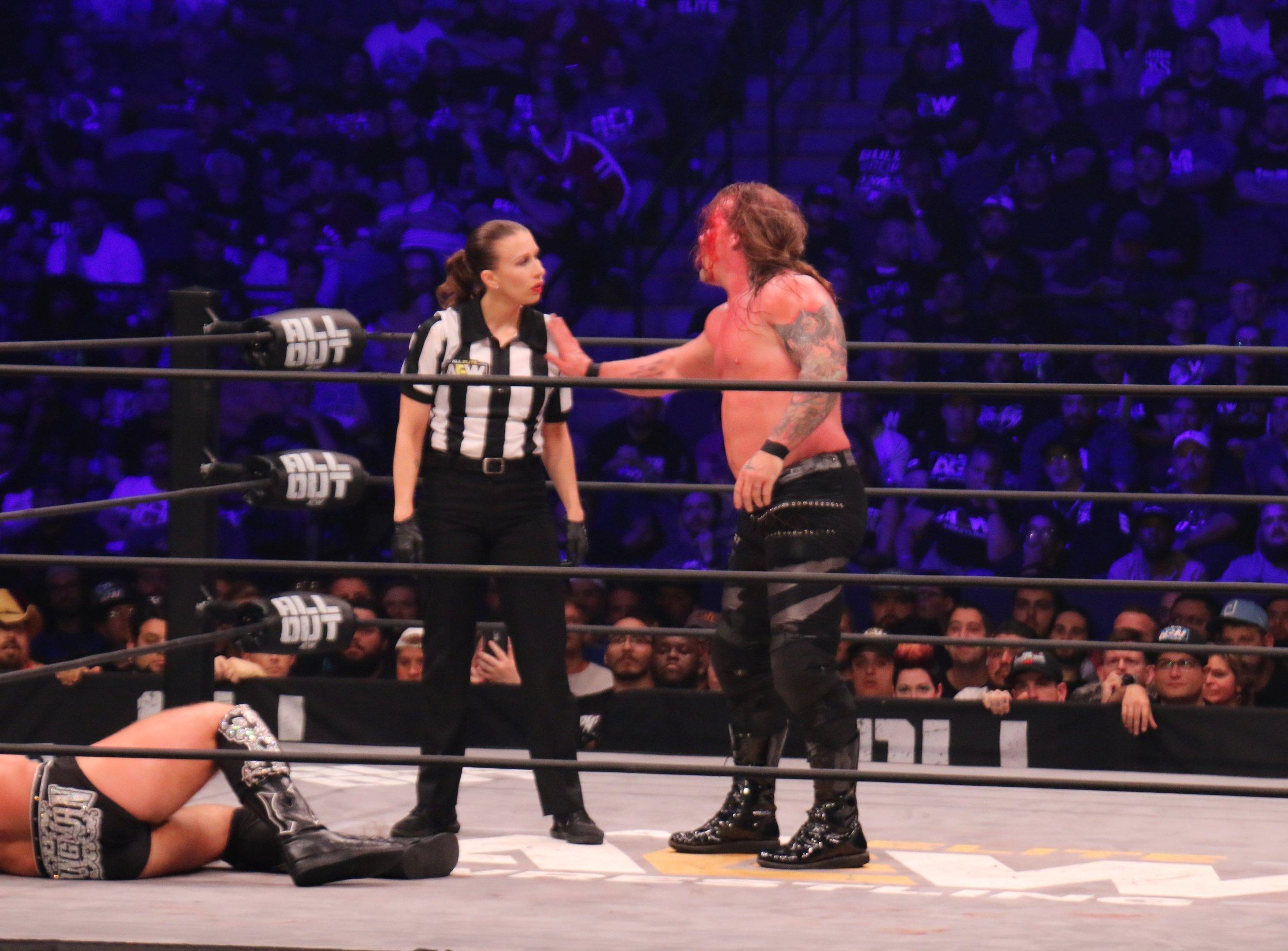 Chris Jericho yells at referee Aubrey Edwards.