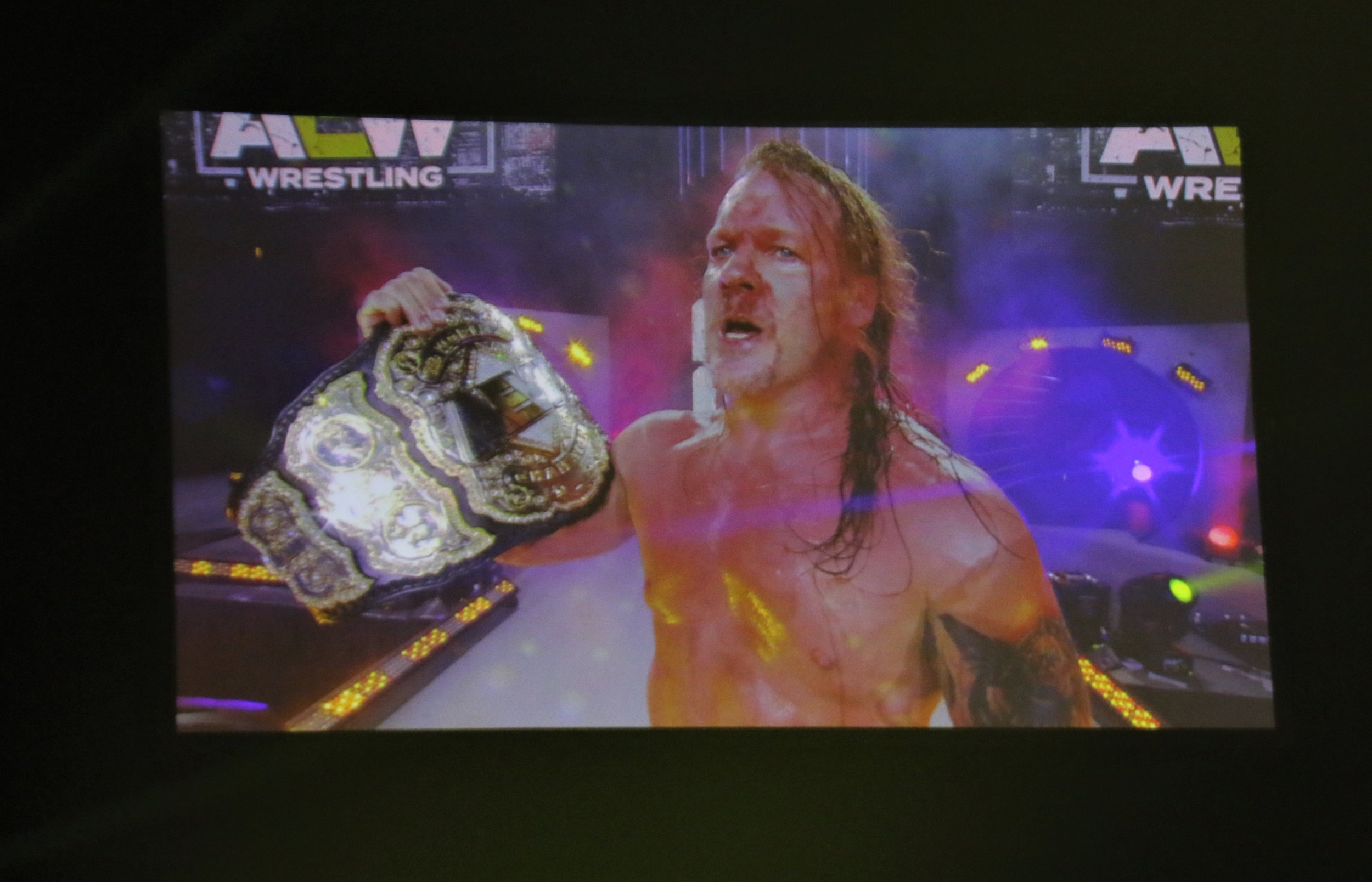 Chris Jericho celebates with the AEW Championship.
