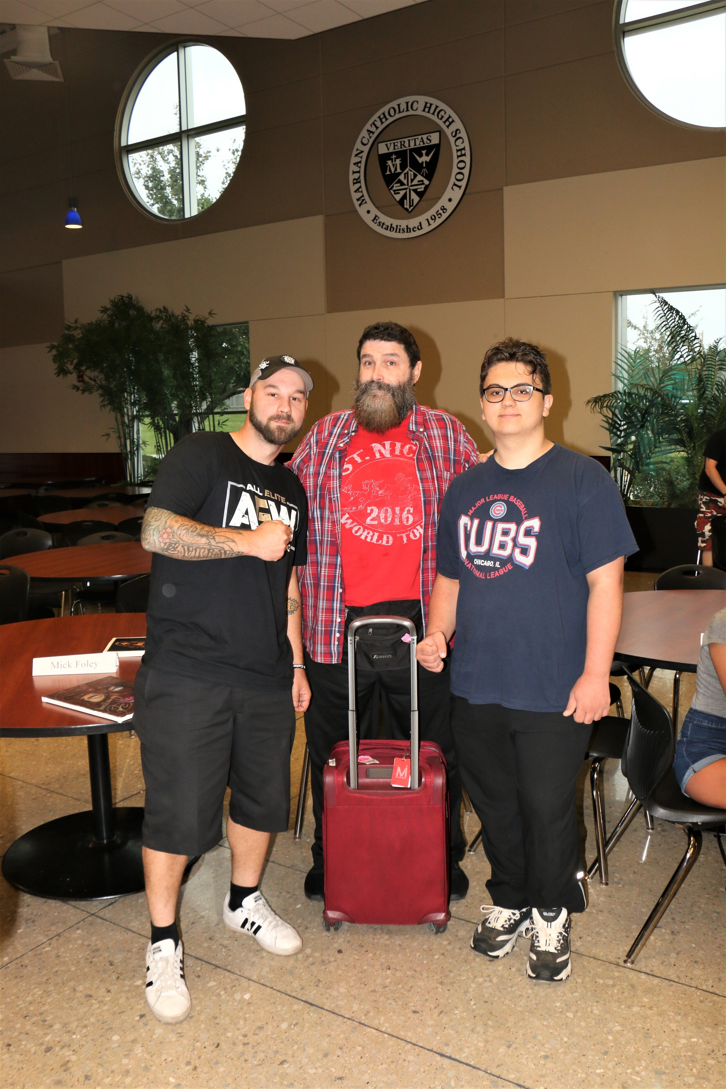 WWE Hall of Famer Mick Foley poses with fans at the Warrior Wrestling 6 VIP Fan Fest.
