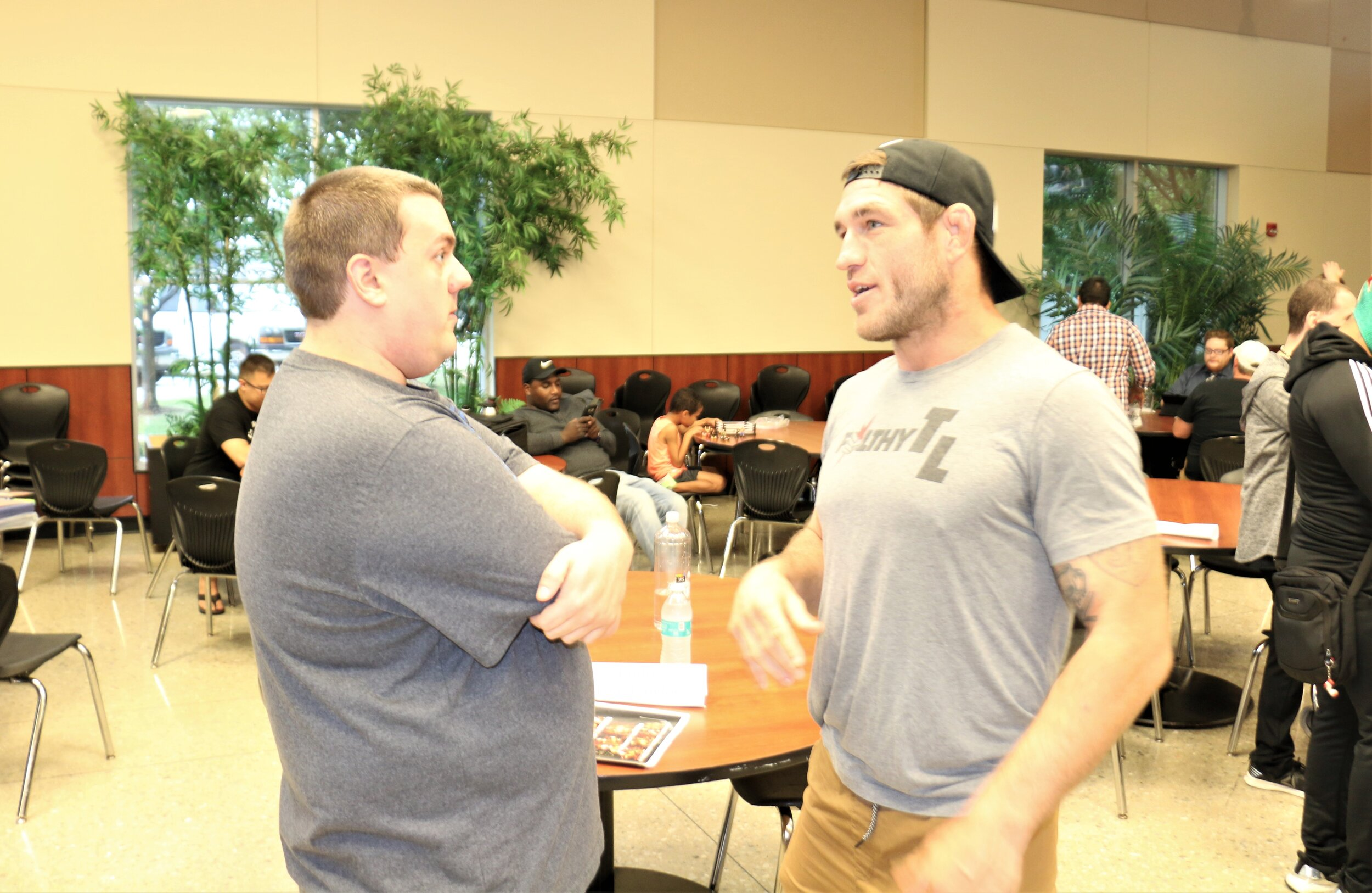"""Filthy"" Tom Lawlor, right, talks with a fan during the Warrior Wrestling 6 VIP Fan Fest."
