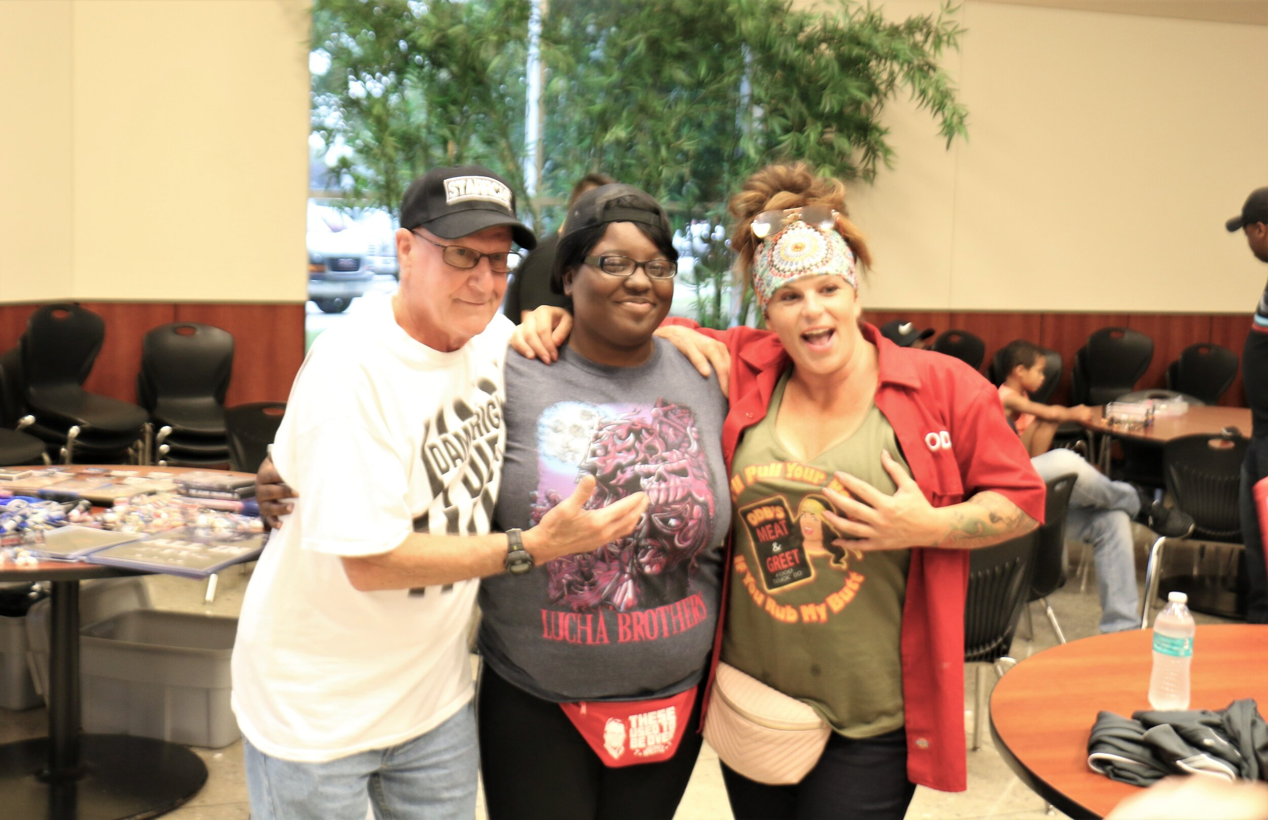 Earl Hebner, left, and ODB, right, pose for a picture for a fan at the Warrior Wrestling 6 VIP Fan Fest.
