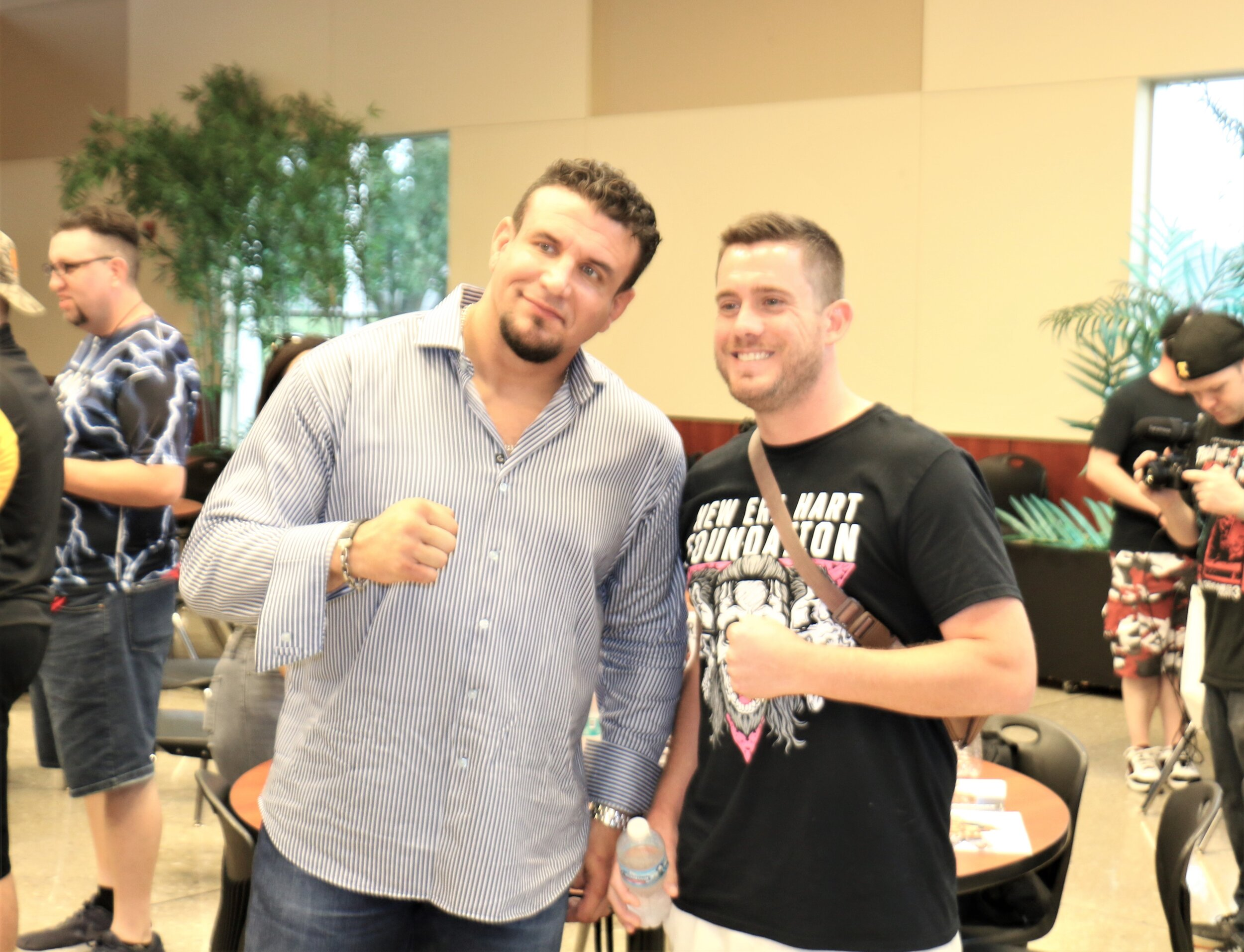 UFC heavyweight legend Frank Mir, left, poses with a fan at the Warrior Wrestling 6 VIP Fan Fest.