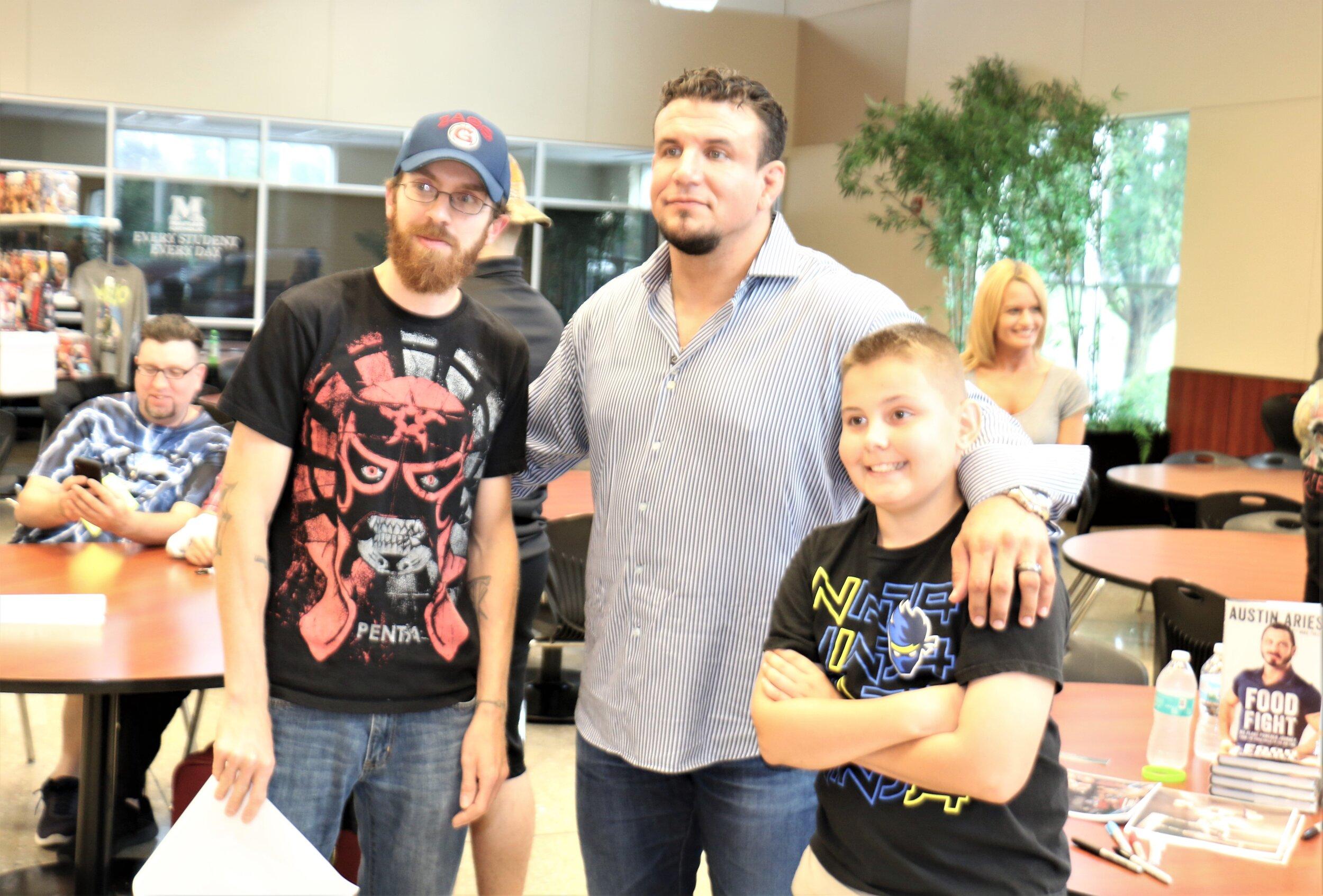 Fans pose with UFC legend Frank Mir, center, at the Warrior Wrestling 6 VIP Fan Fest.