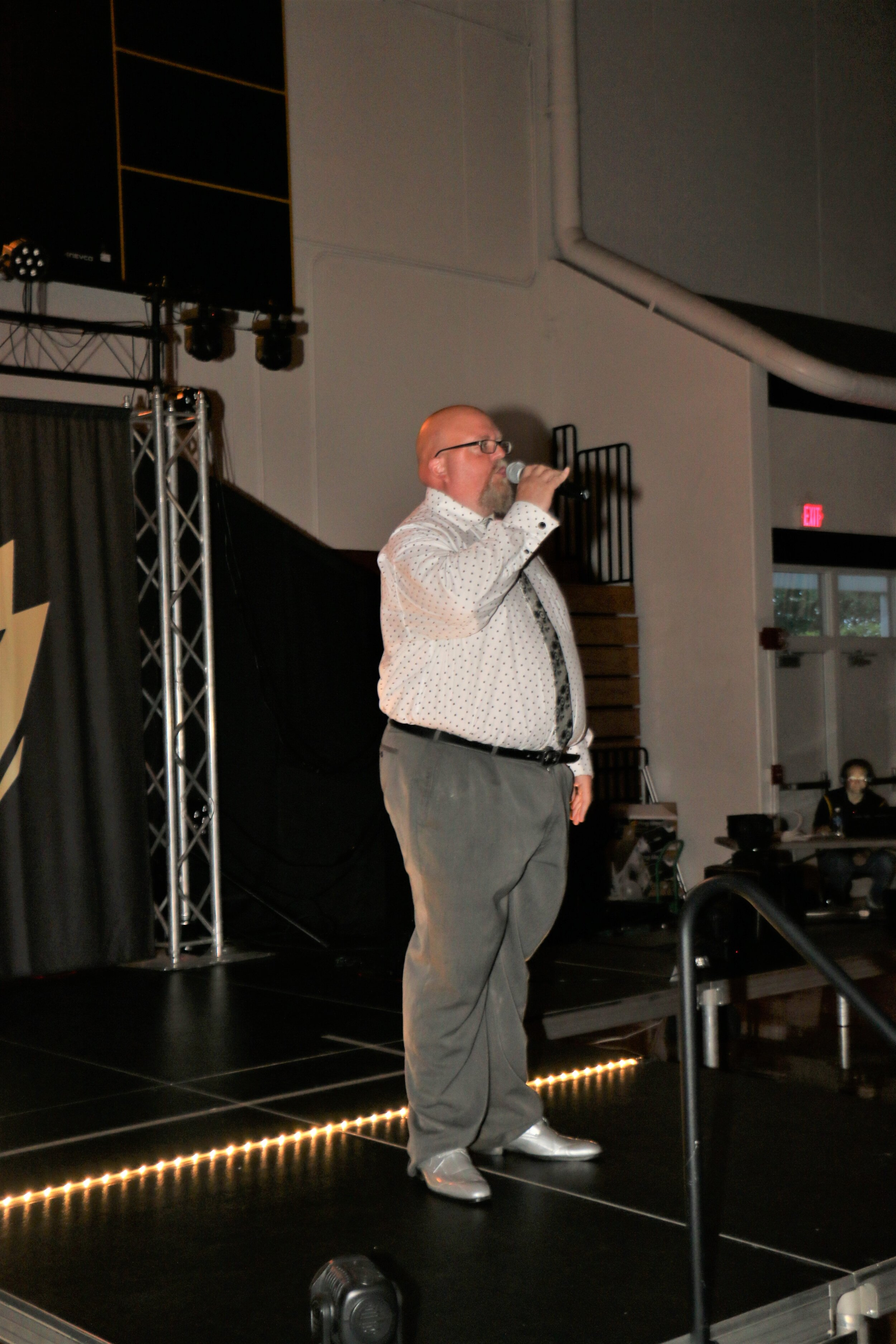 Ring announcer Kirby Van Vliet welcomes fans to Warrior Wrestling 6.