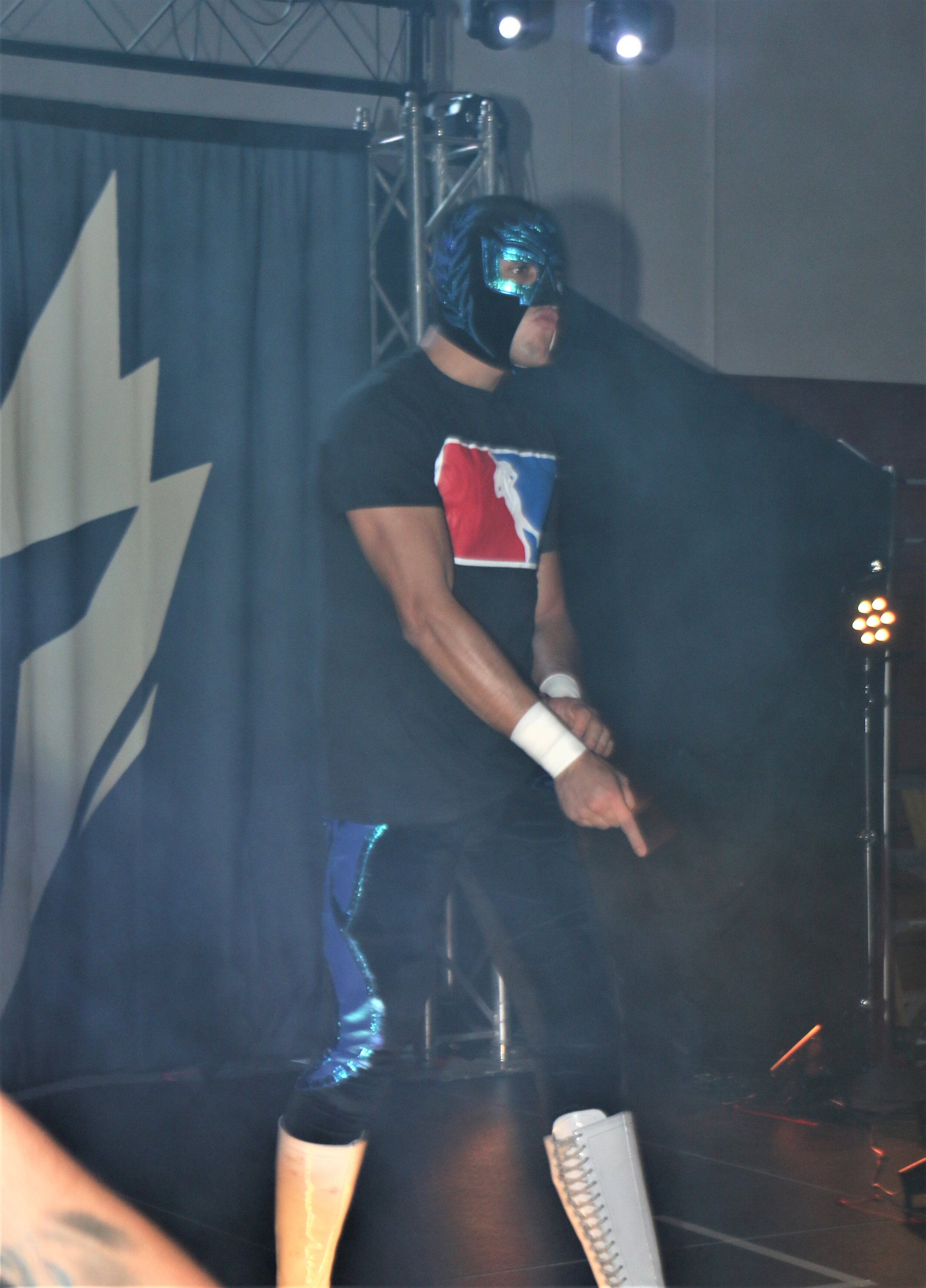 Sobreano Jr. enters the arena for his match against Templario.
