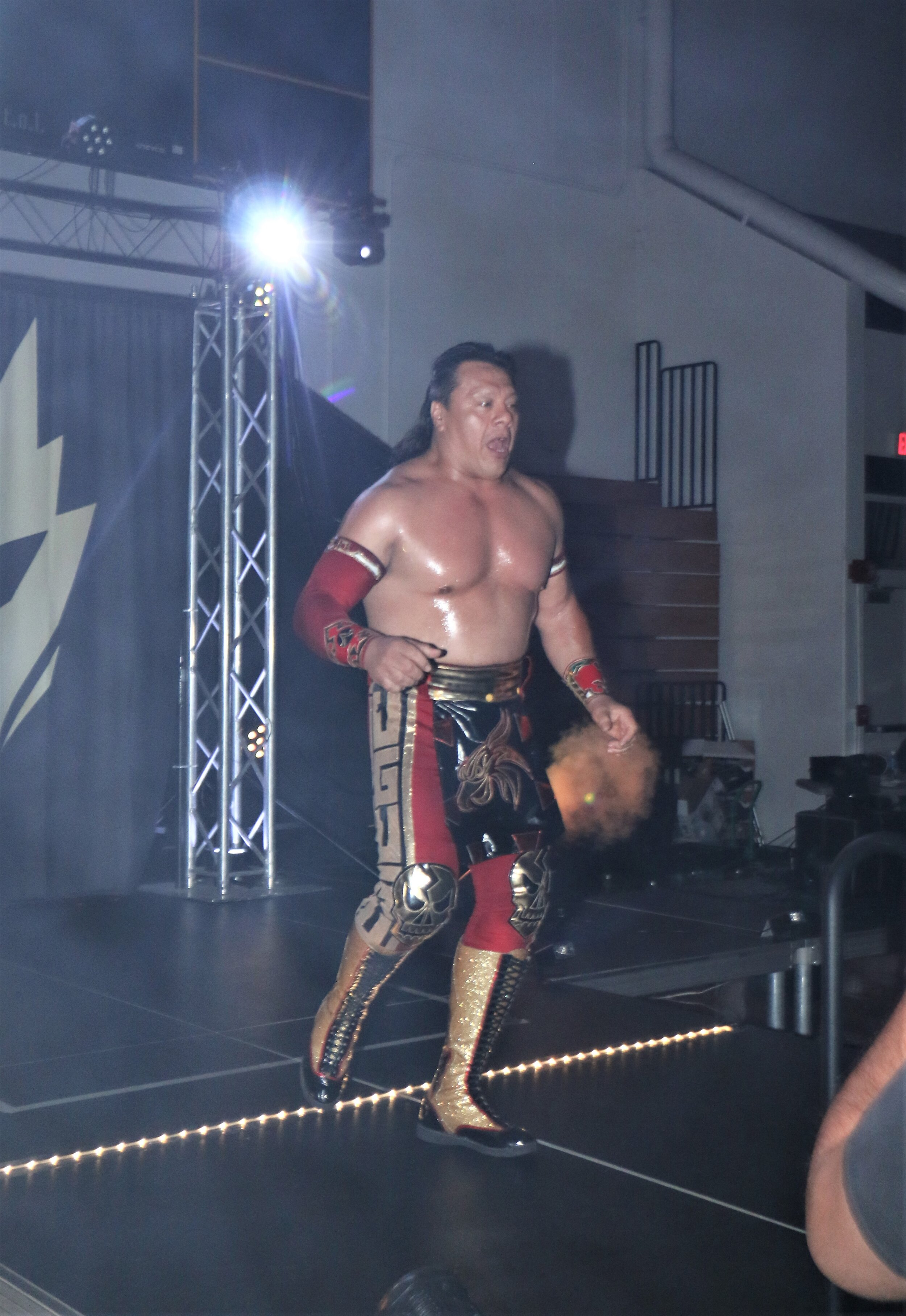 Ultimo Guerrero enters the arena for the 3-way match.