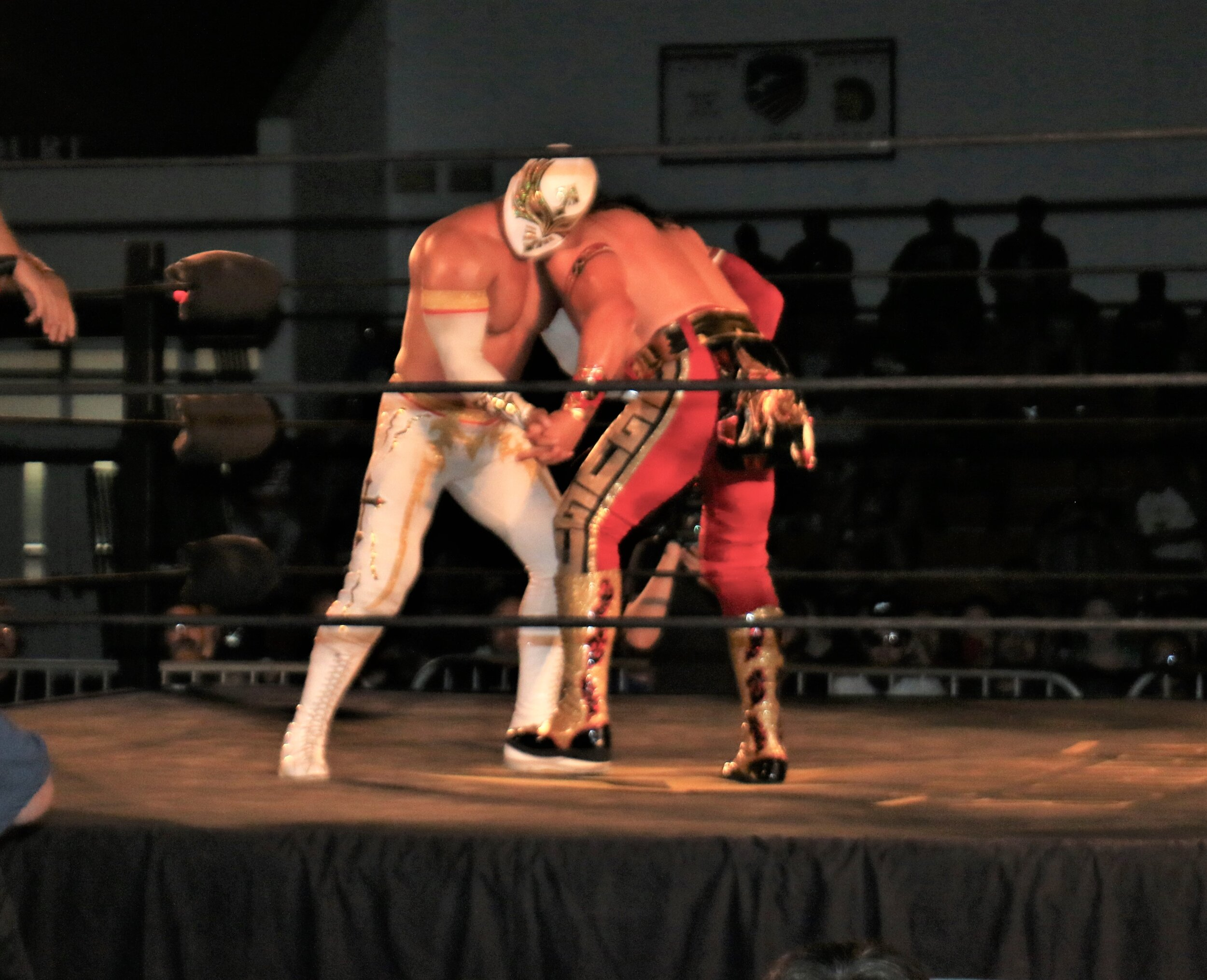 Caristico, left, locks up with Ultimo Guerrero.