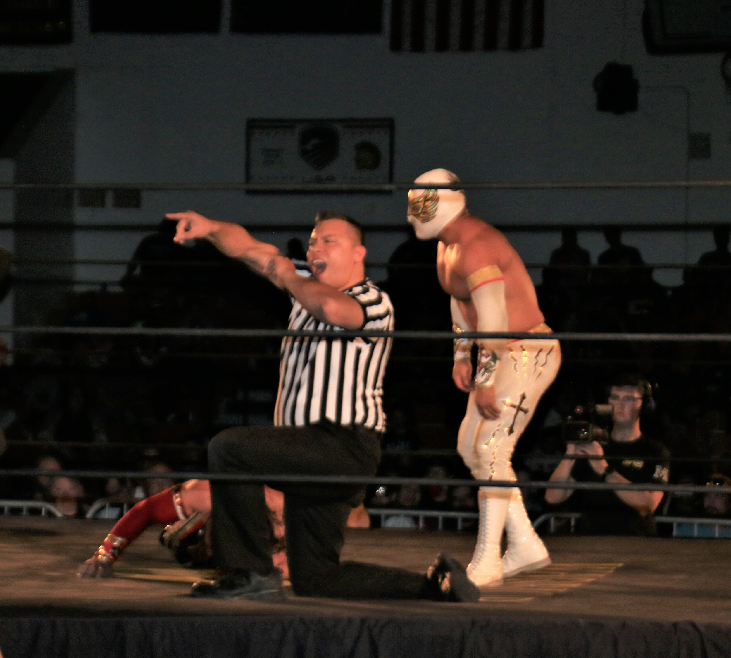 Referee Jeremy Tillema calls for the bell after Caristico earned the submission victory in the 3-way match.