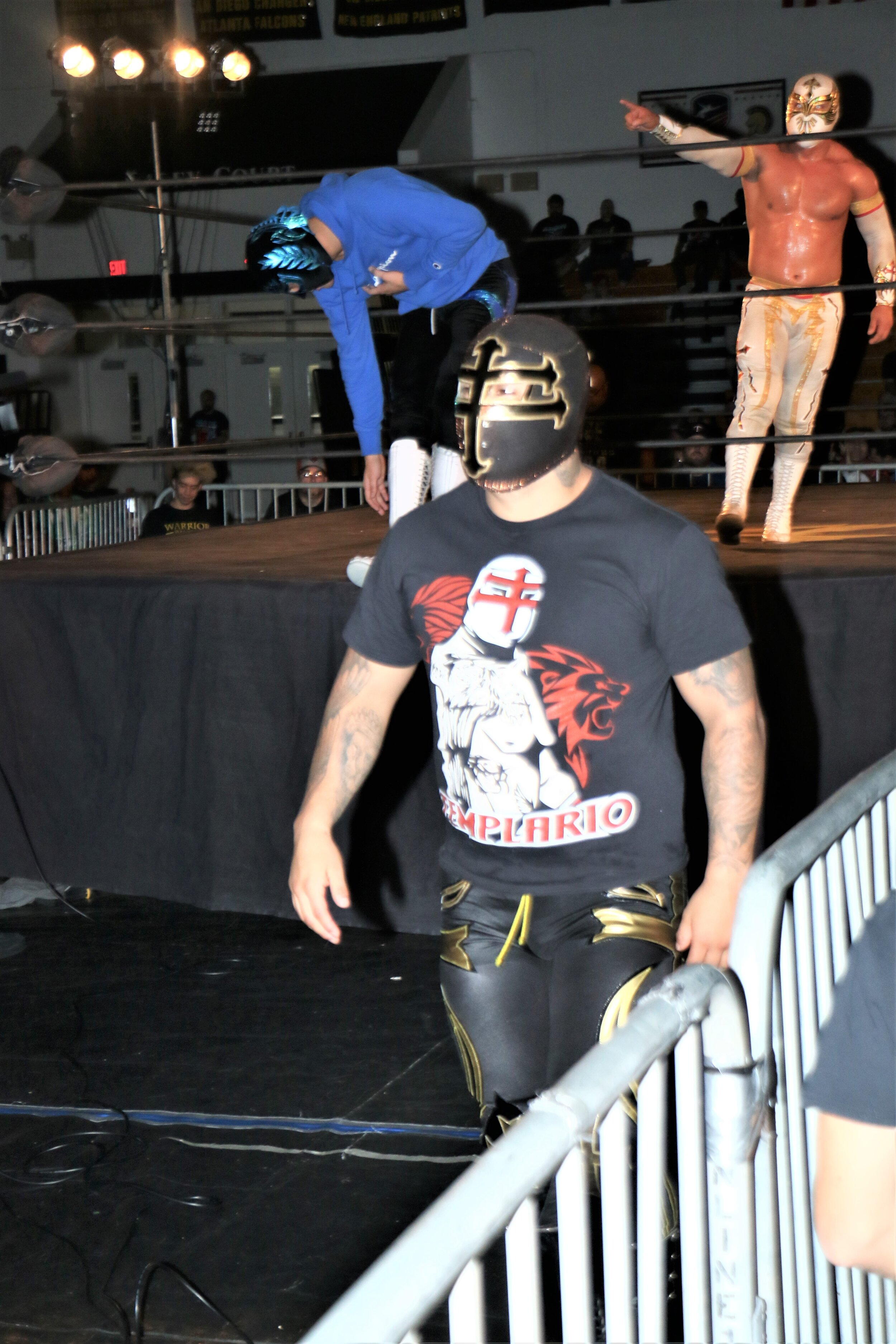 Templario walks backstage after helping out his fellow luchadors.