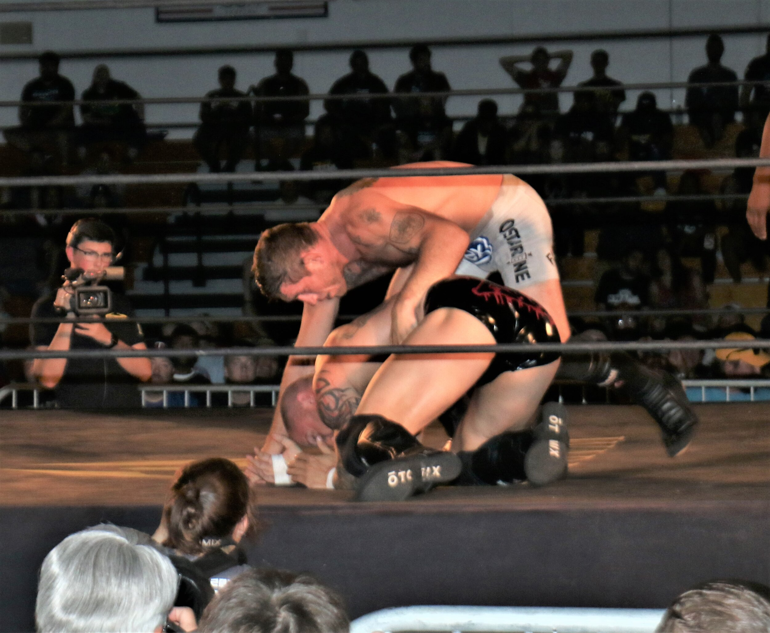 """Filthy"" Tom Lawlor, top, tangles with Killer Kross."