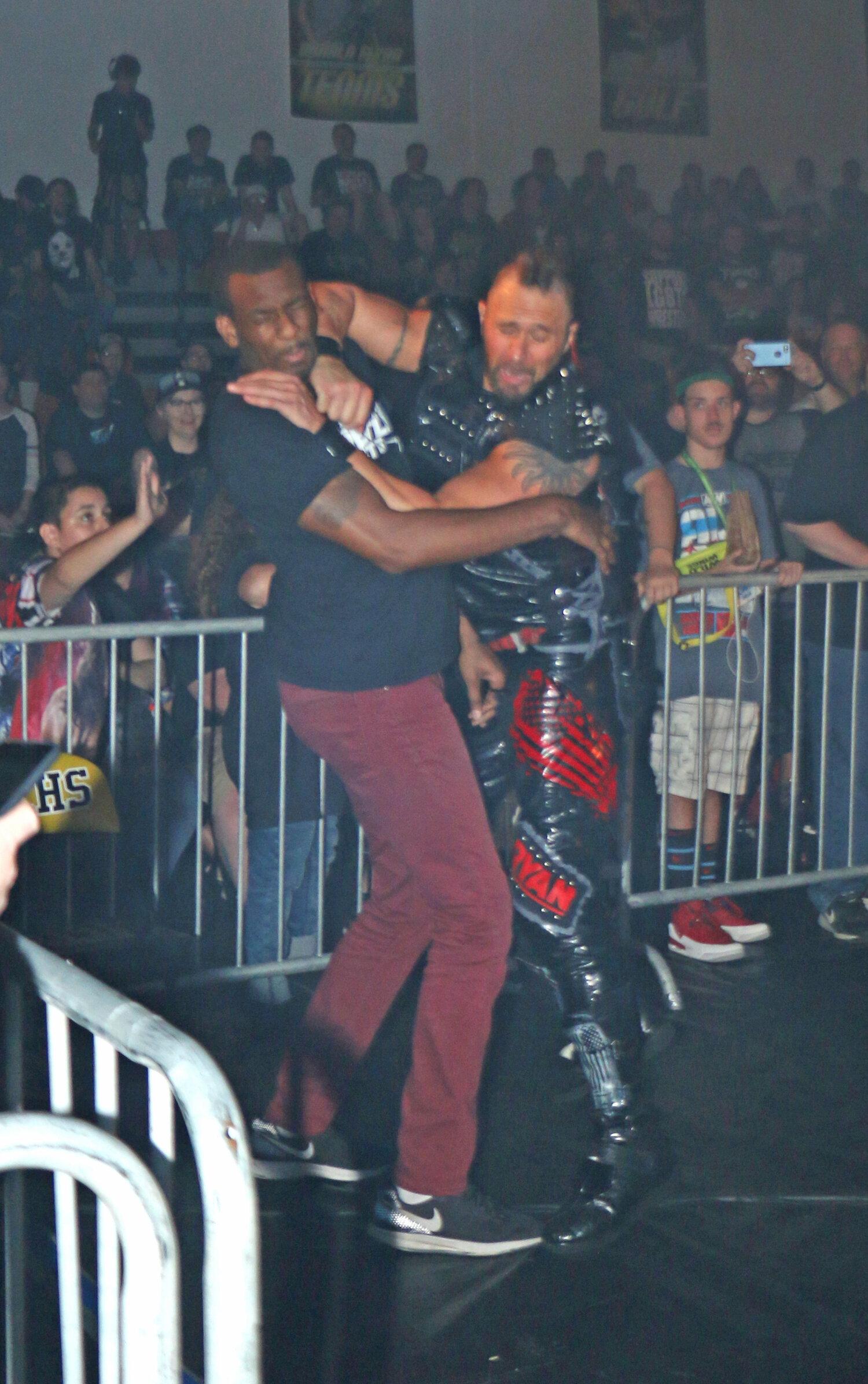 Lance Archer delivers a shot to Darius Latrell, who was acting a security at ringside.