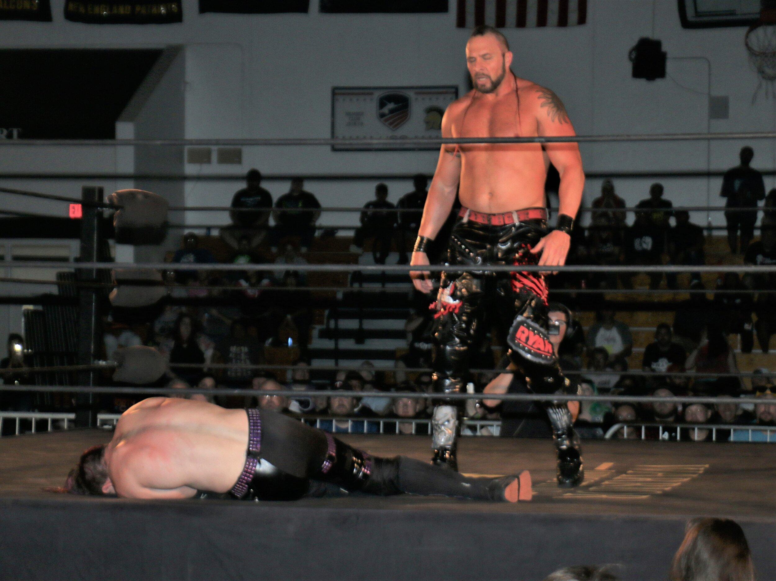 Lance Archer stands over Alex Zayne.