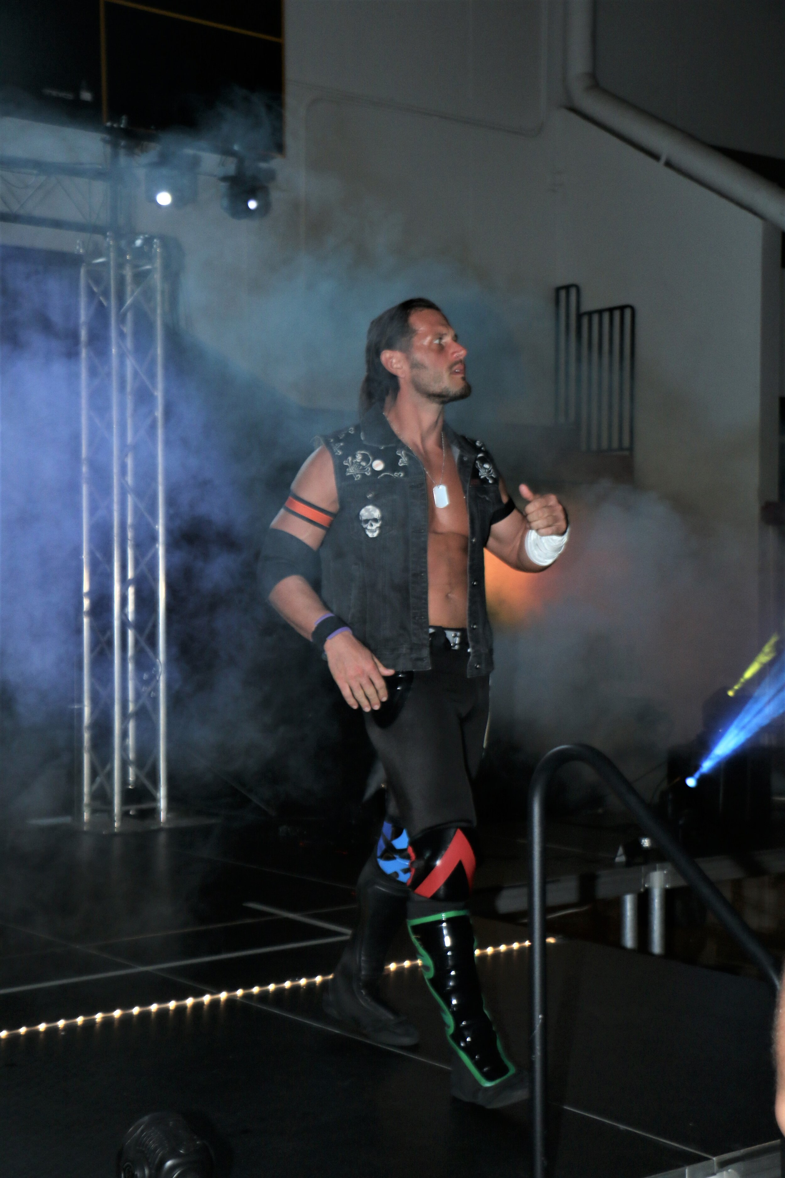 Alex Shelley enters the arena.