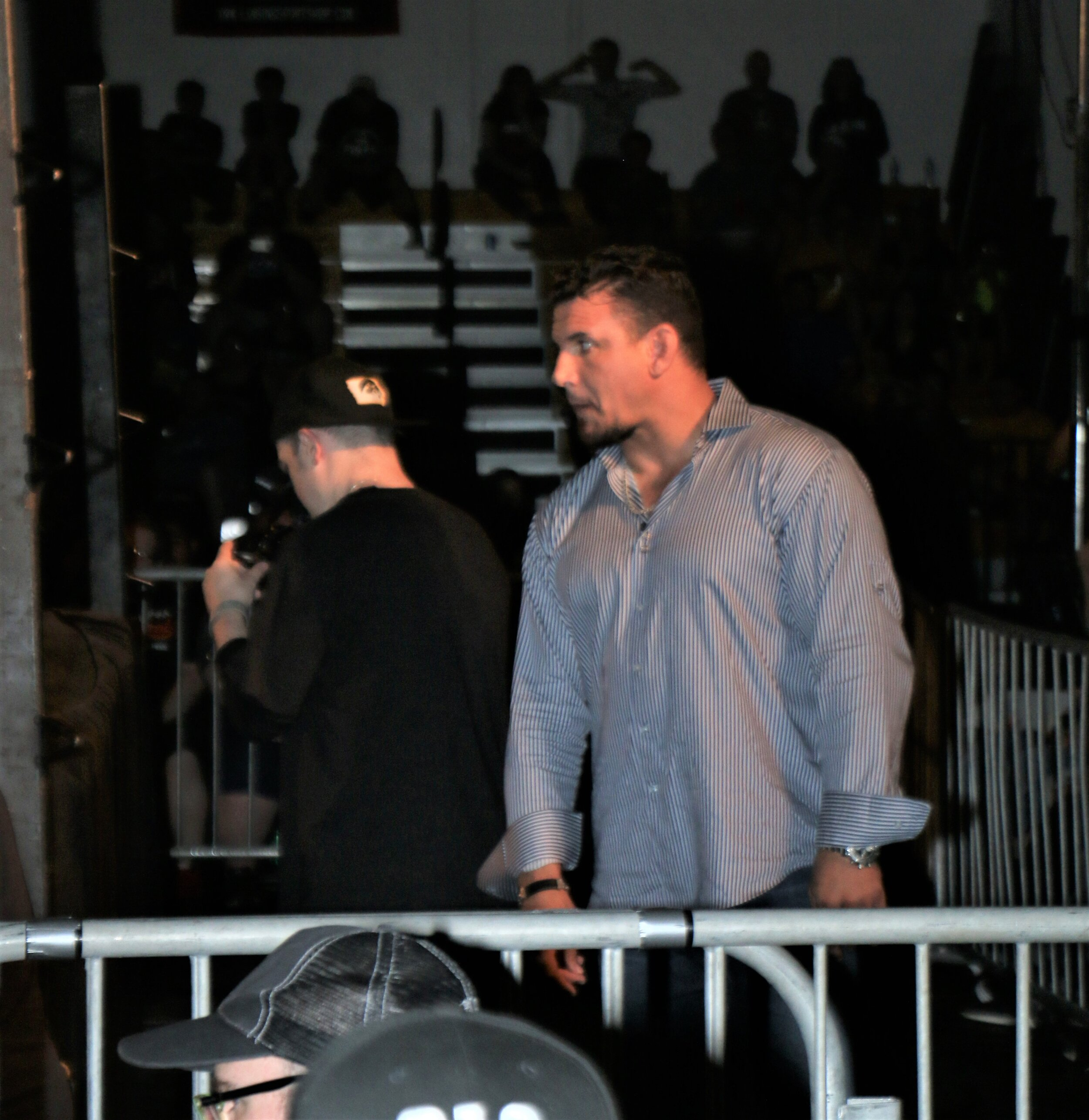 Frank Mir observes the Austin Aries-Alex Shelley match at ringside.