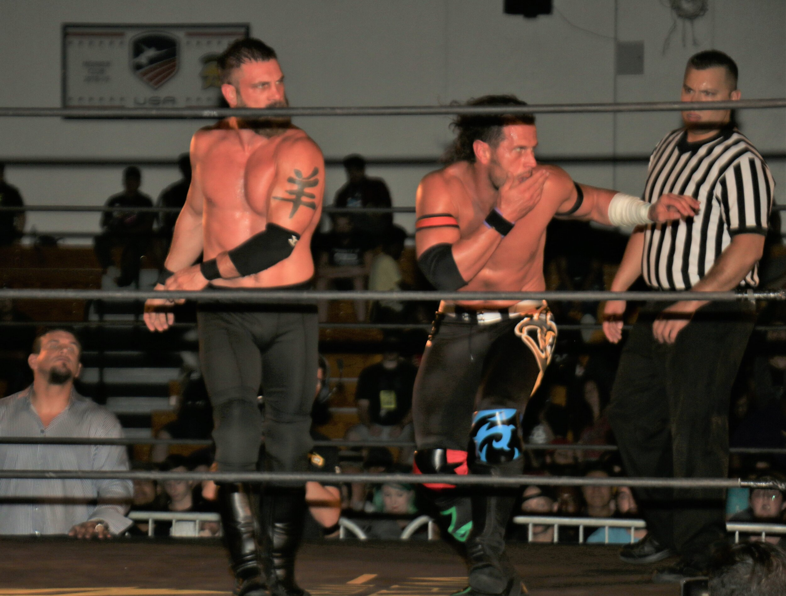 Austin Aries, left, trades blows with Alex Shelley.