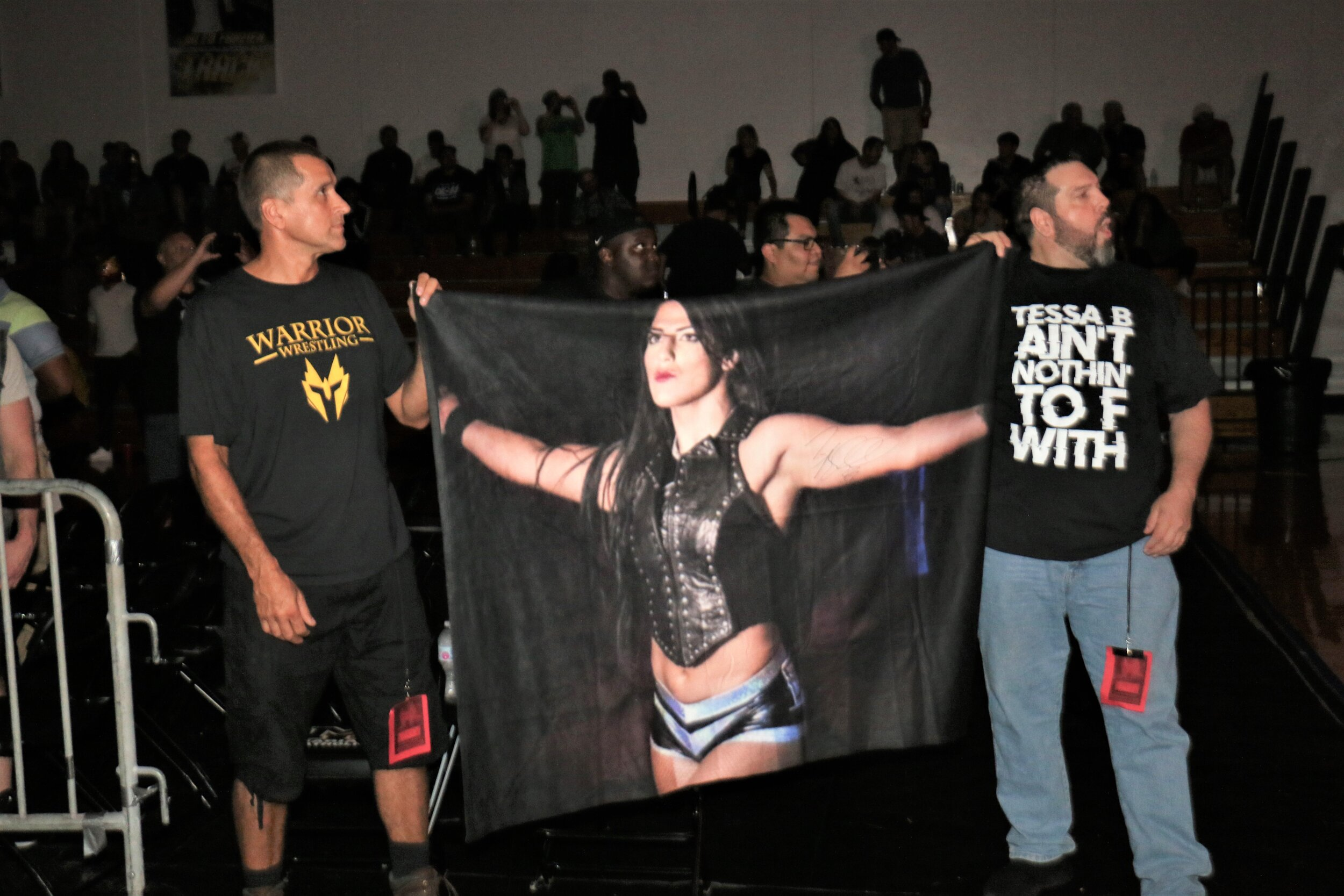Fans hold up a banner for Tessa Blanchard.