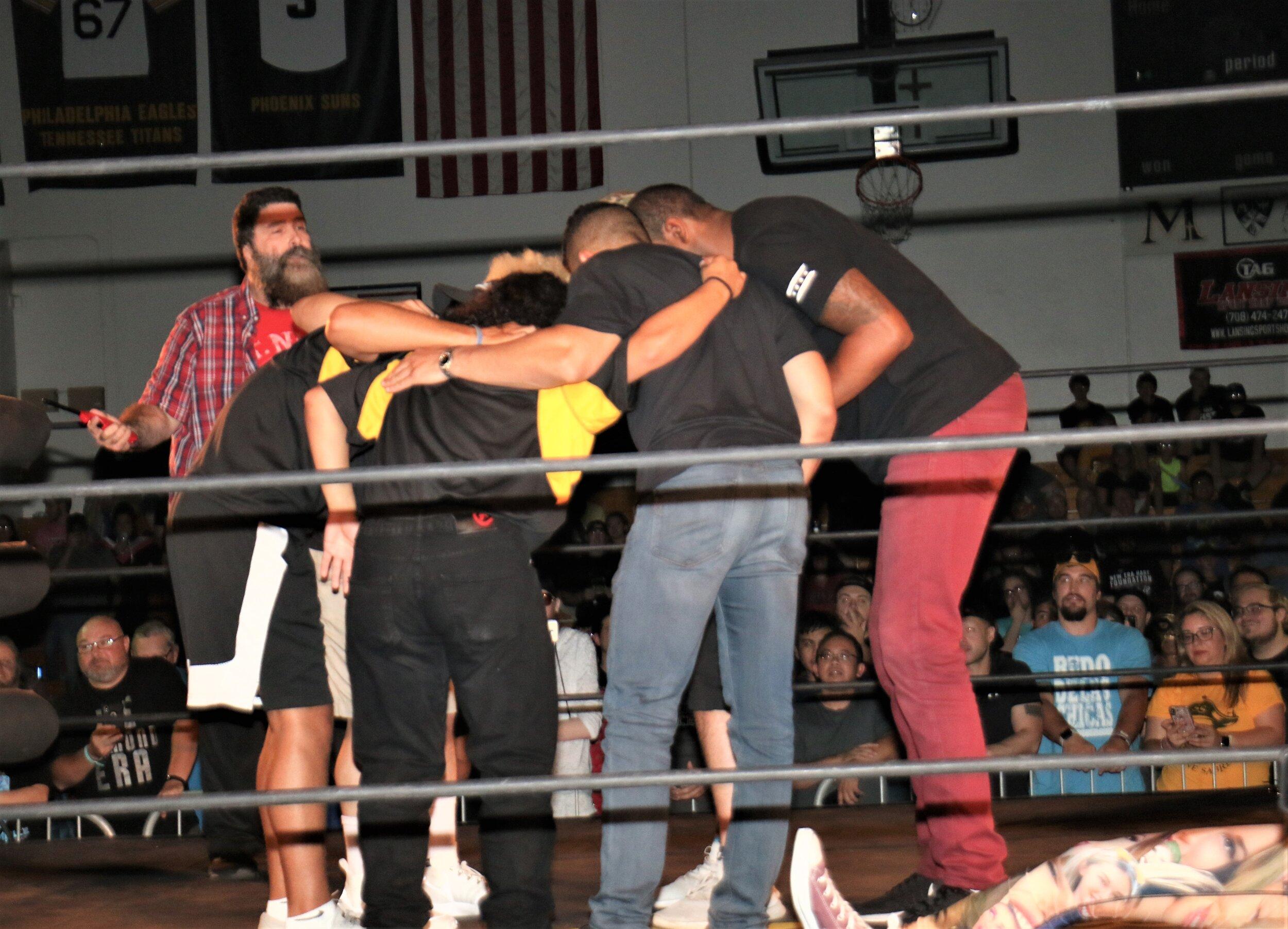 Warrior Wrestling security huddles up.
