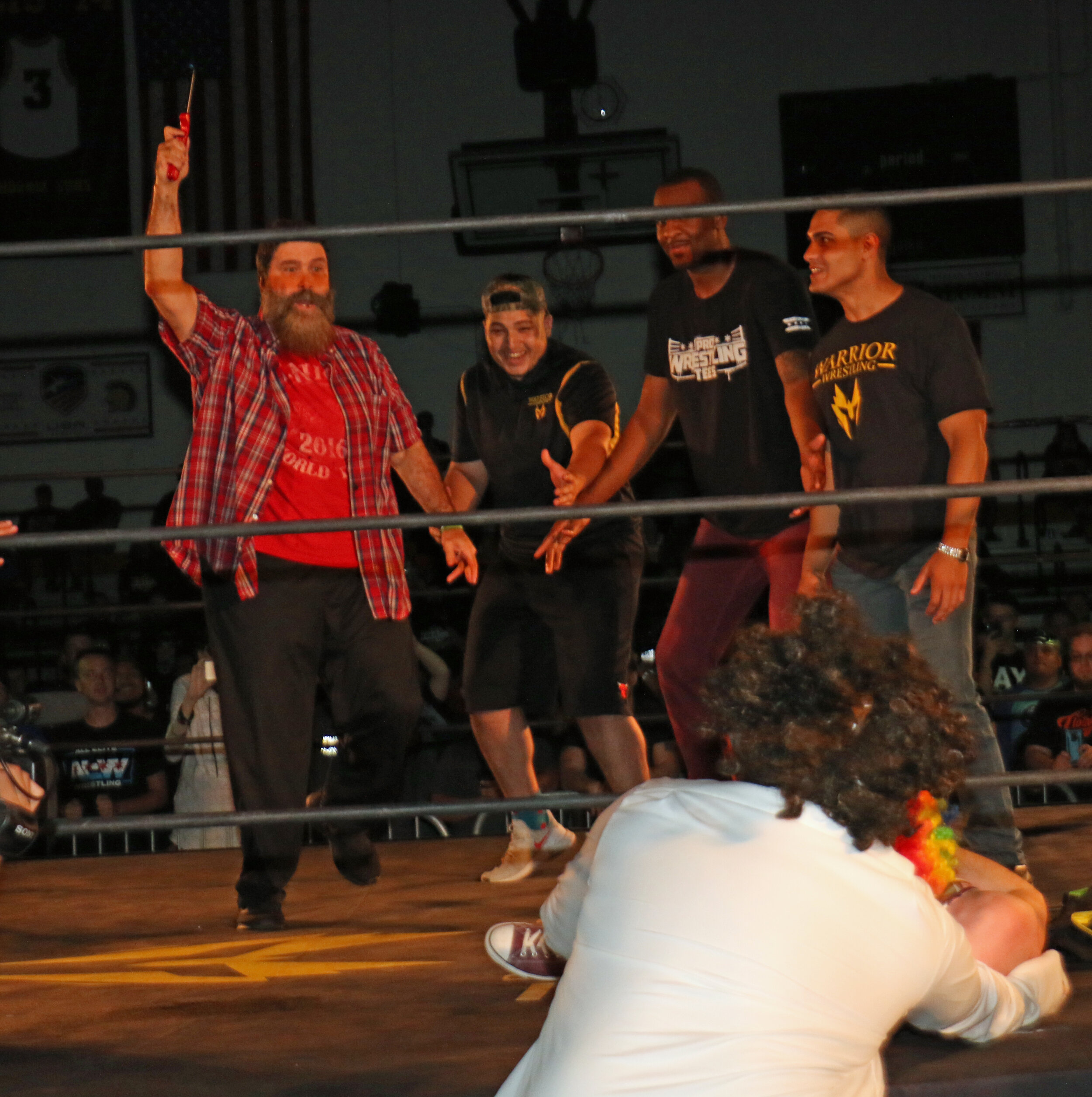 Before Mick Foley could light Frank the Clown on fire, Frank's friends make the save.