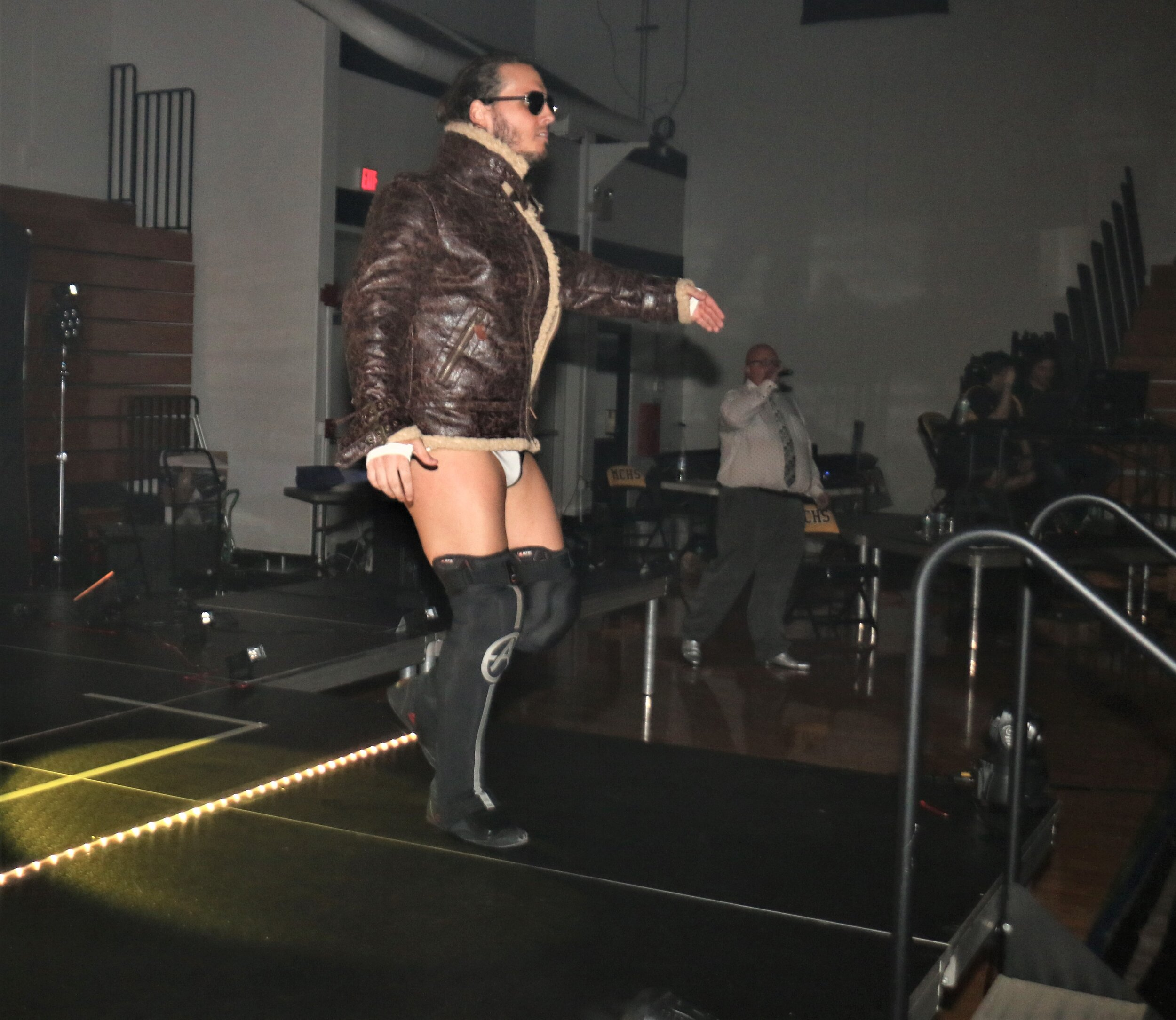 Andrew Everett enters the arena for his match against Dragon Lee.
