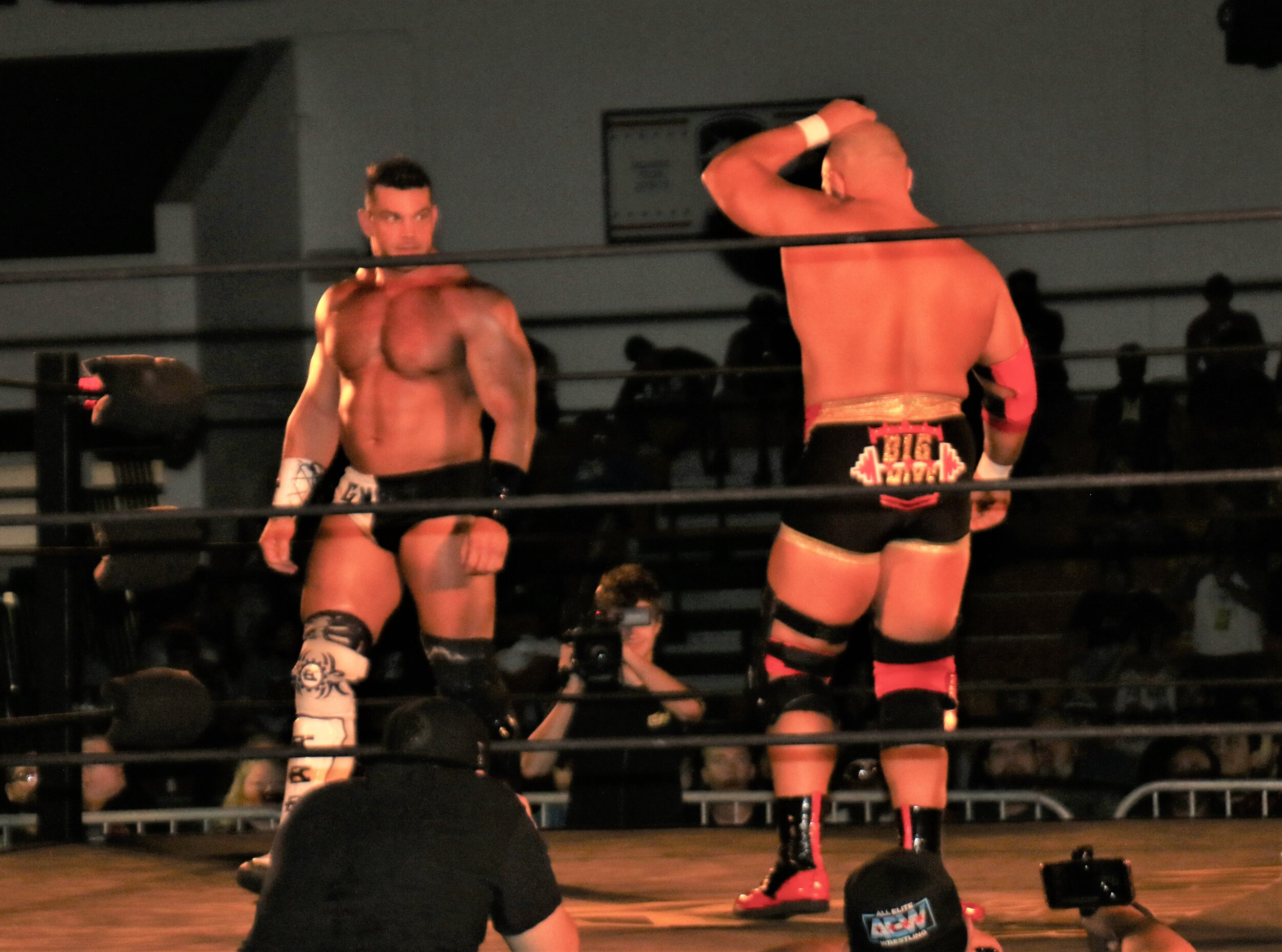 Brian Cage, letf, faces off with Michael Elgin.