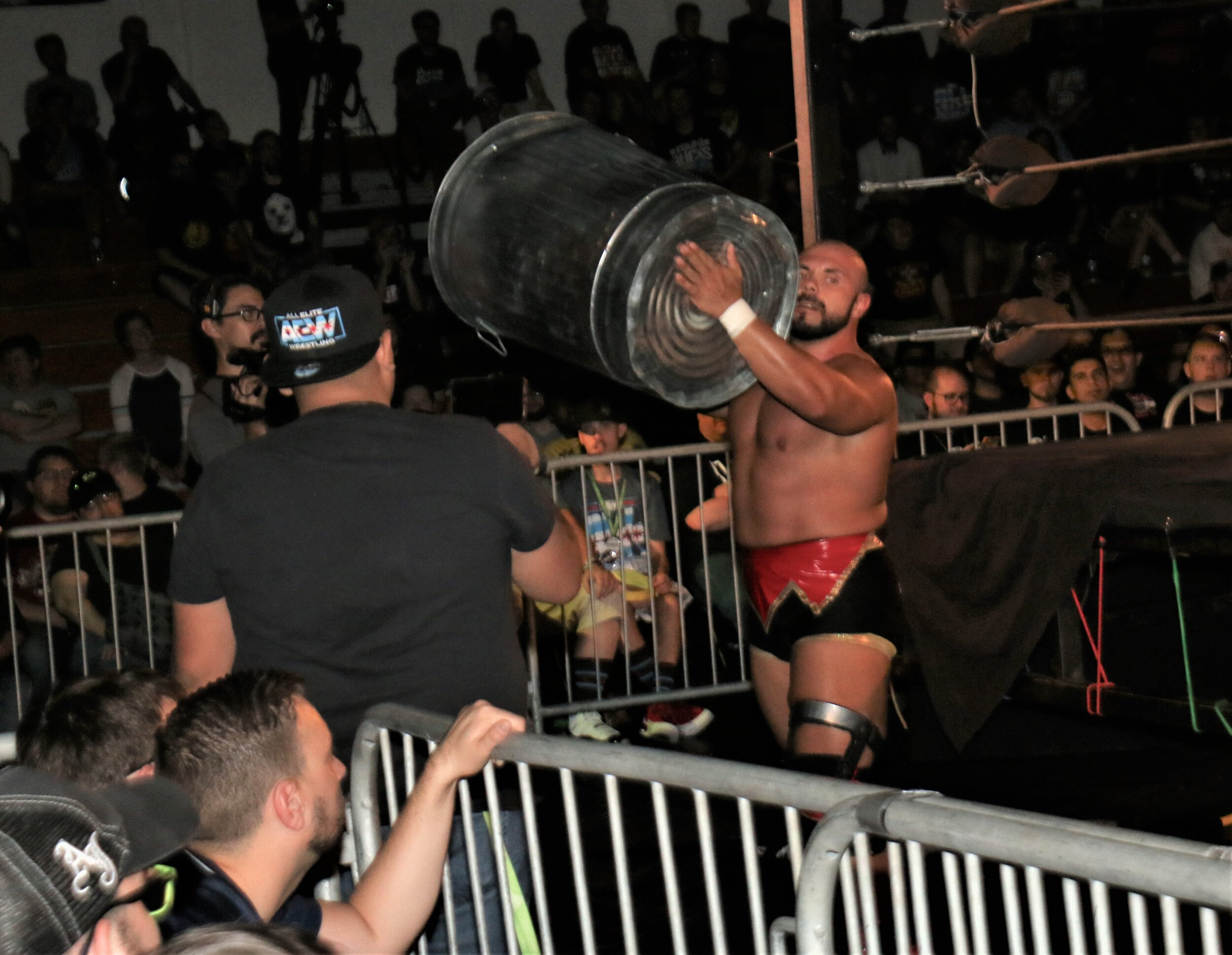 Michael Elgin pulls off a garbage can.