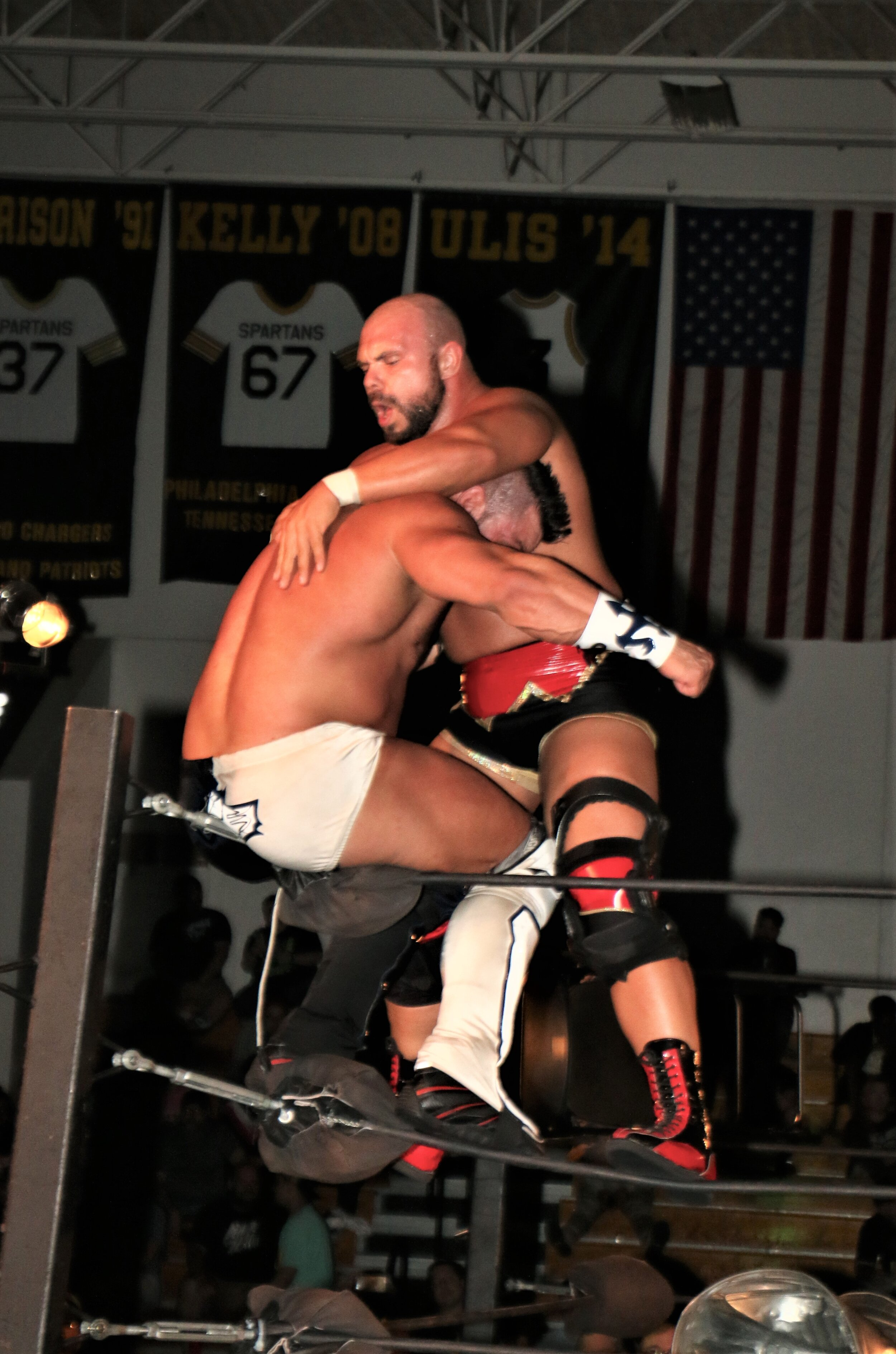 Michael Elgin is thinking superplex on Brian Cage.