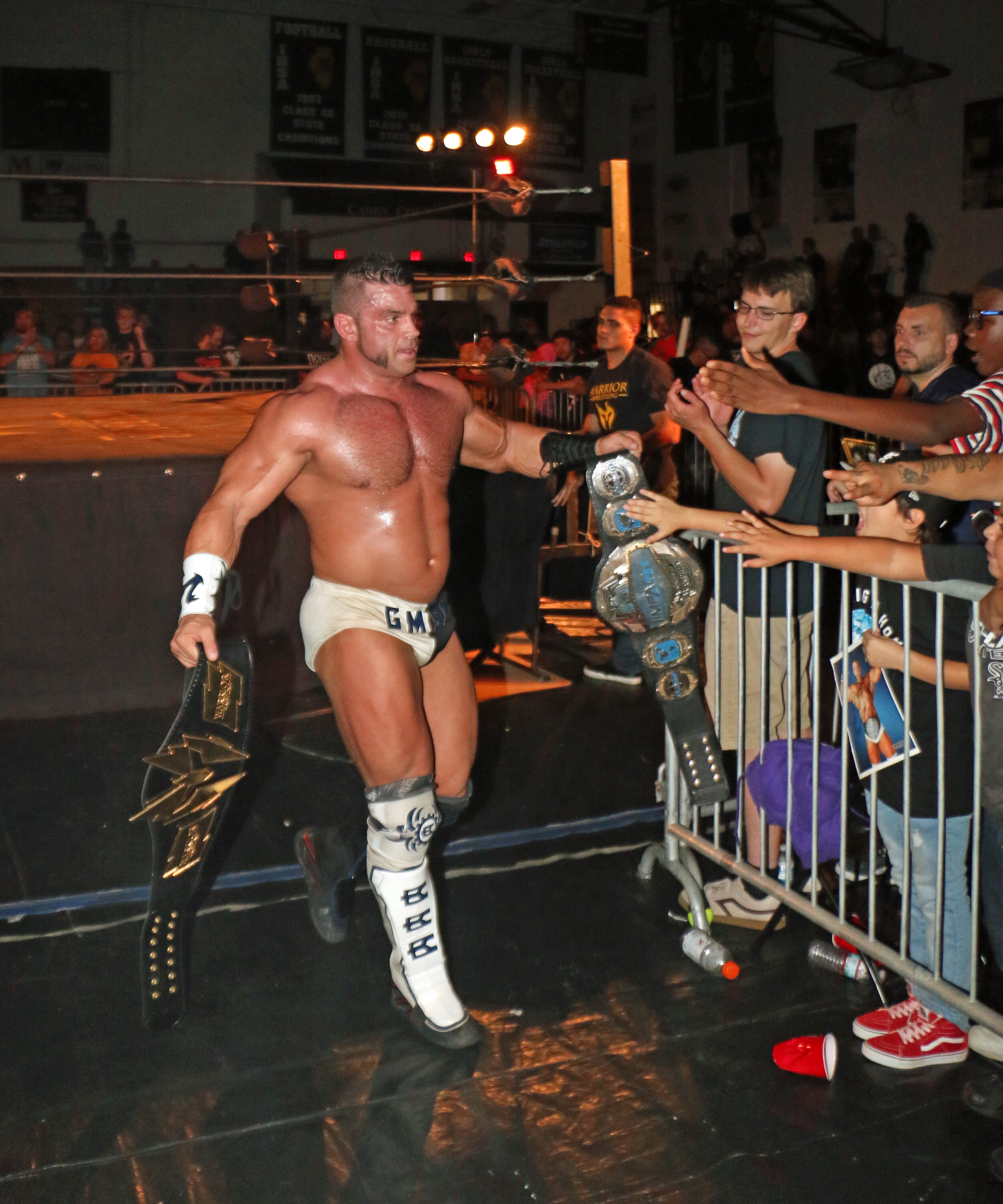 Brian Cage celebrates his victory with the fans.