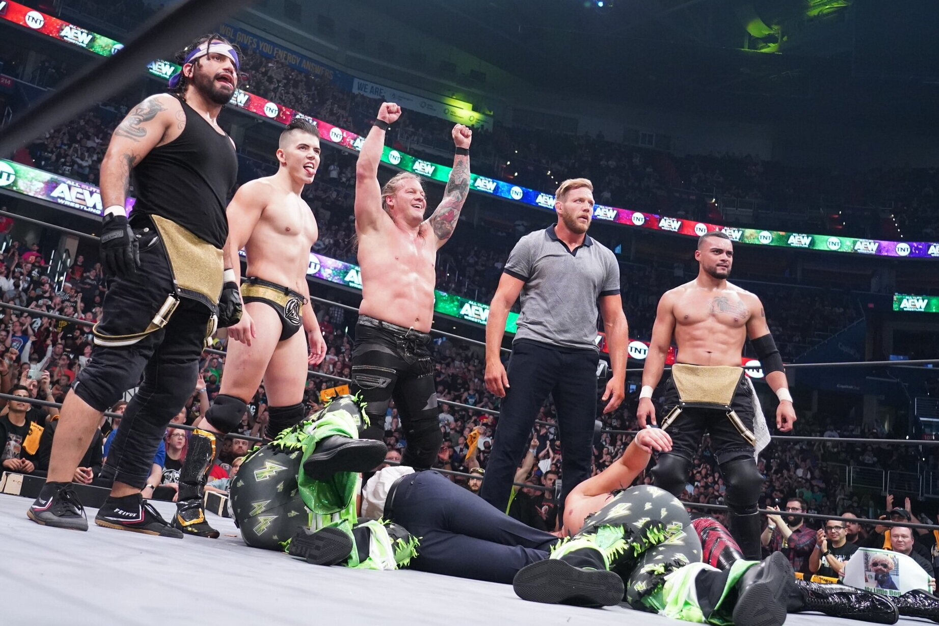Ortiz (from left), Sammy Guevara, Chris Jericho, Jake Hager and Santana stand over the decimated Young Bucks as AEW Dynamite went off the air Wednesday night.  (Photo courtesy AEW/Lee South)