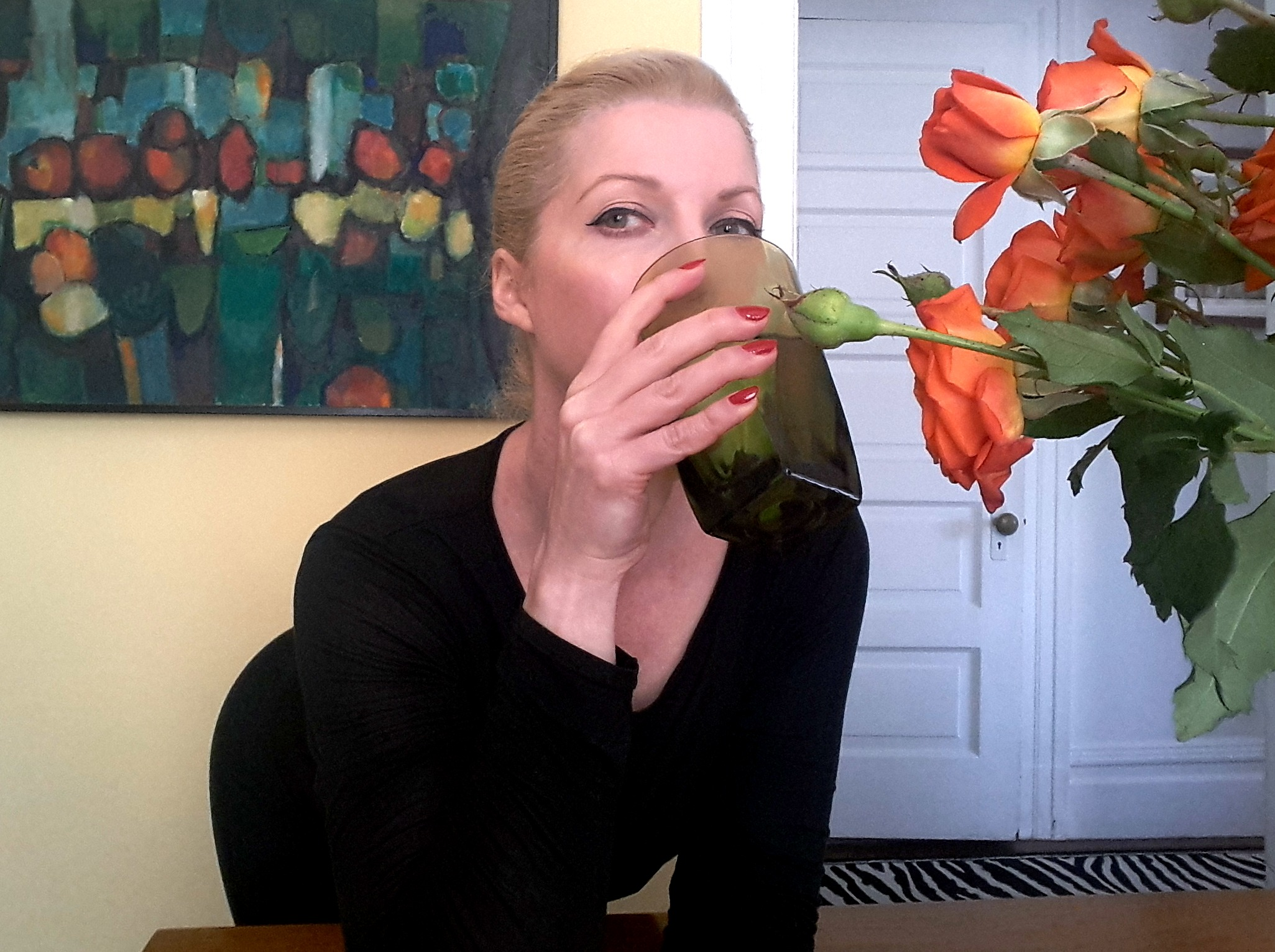 Marci+Bowman-drinking-water-orange-roses.jpg