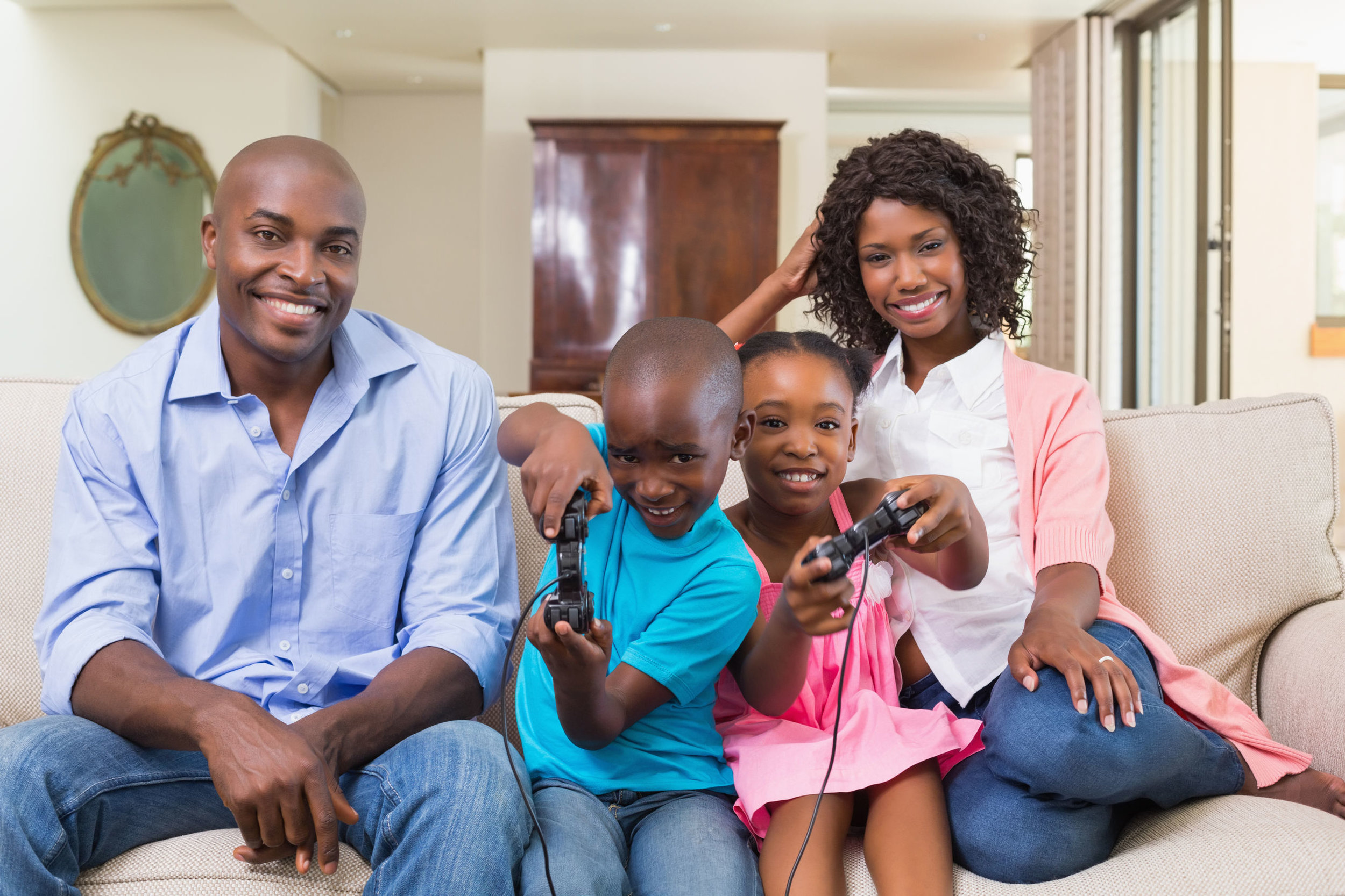 blackkidsandfamilyplayinggames.jpg