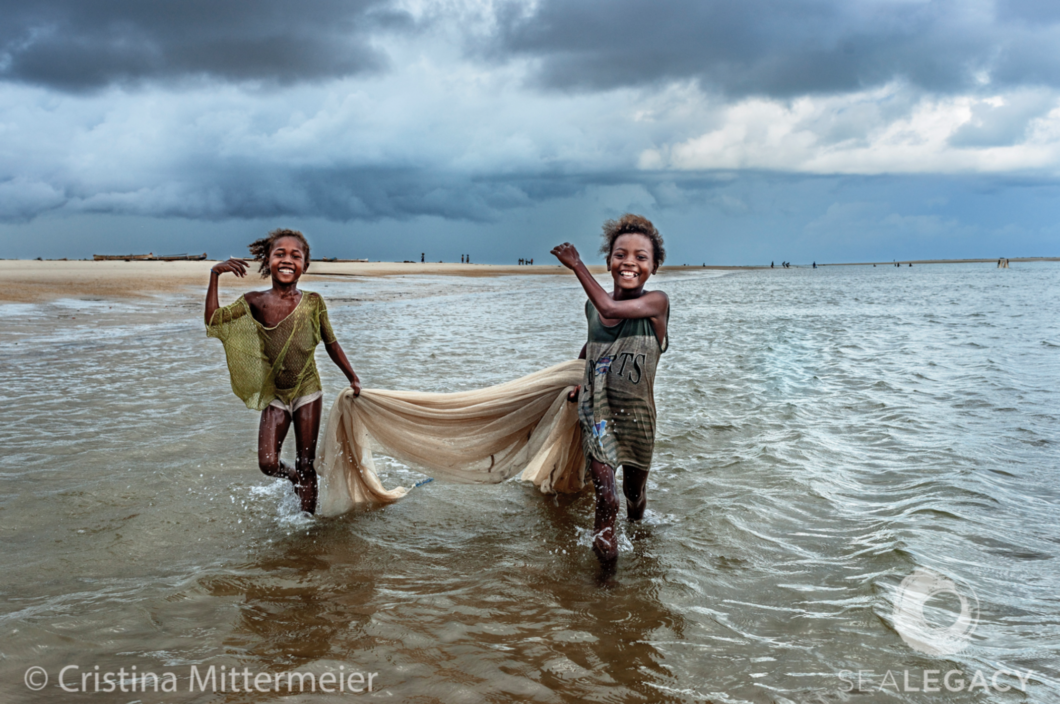 Cristina Mittermeier, Fishing Girls  Dye Sublimation Print on Metal, 40x60 in.